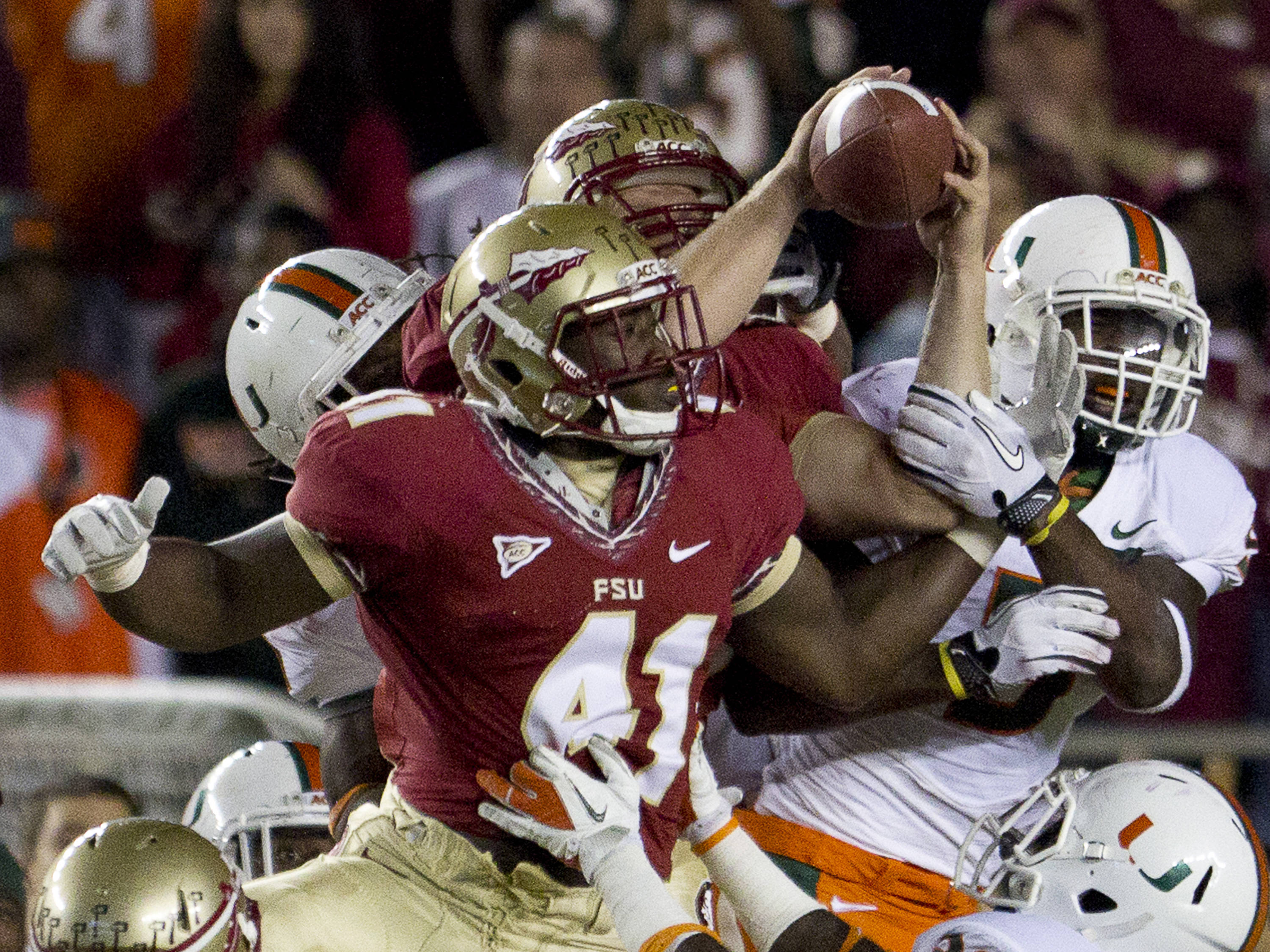 FSU takes possession of the ball after the on-side kick during the football game against Miami on November 12, 2011.