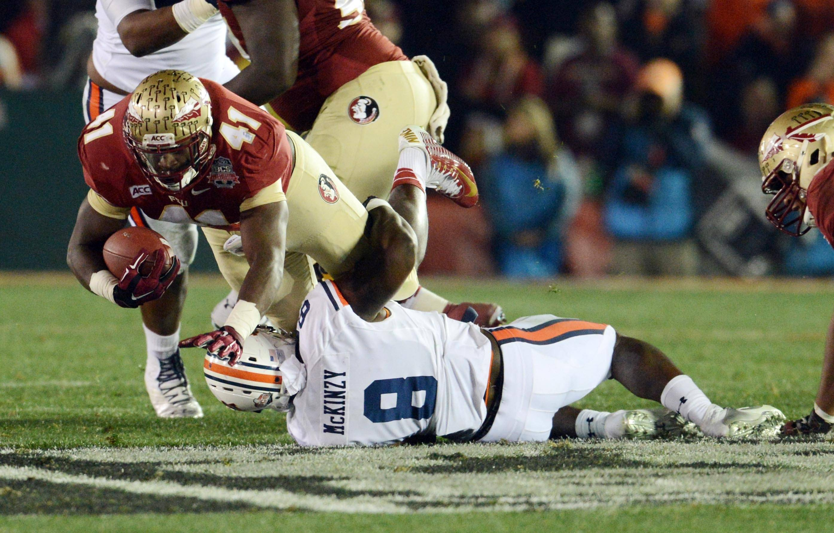 Jan 6, 2014; Pasadena, CA, USA; Florida State Seminoles fullback Chad Abram (41) is tackled by Auburn Tigers linebacker Cassanova McKinzy (8) during the second half of the 2014 BCS National Championship game at the Rose Bowl.  Mandatory Credit: Jayne Kamin-Oncea-USA TODAY Sports