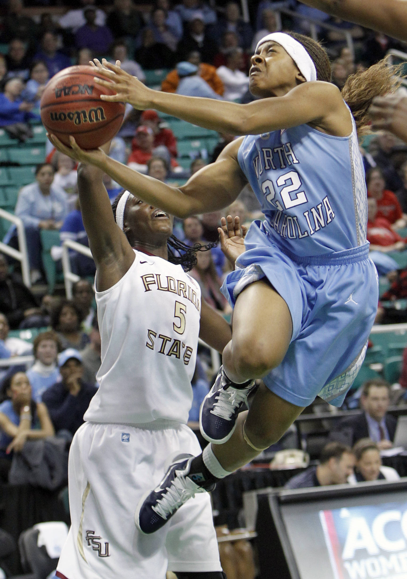 North Carolina's Cetera DeGraffenreid (22) drives past Florida State's Christian Hunnicutt in the second half of North Carolina's 78-65 win in an Atlantic Coast Conference women's basketball tournament game. (AP Photo/Chuck Burton)