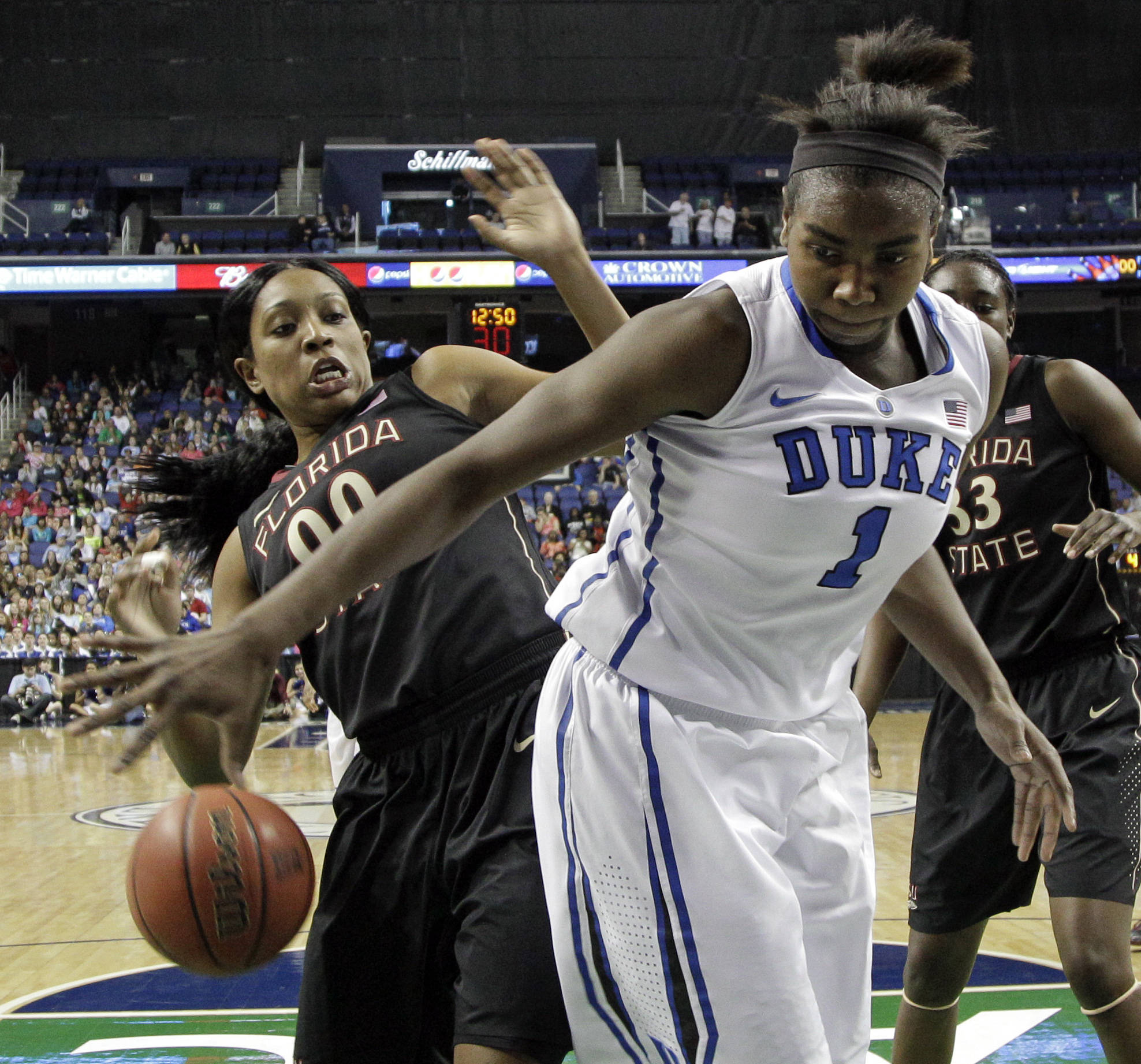 Duke's Elizabeth Williams (1) and Florida State's Chasity Clayton (00) battle for a rebound. (AP Photo/Chuck Burton)