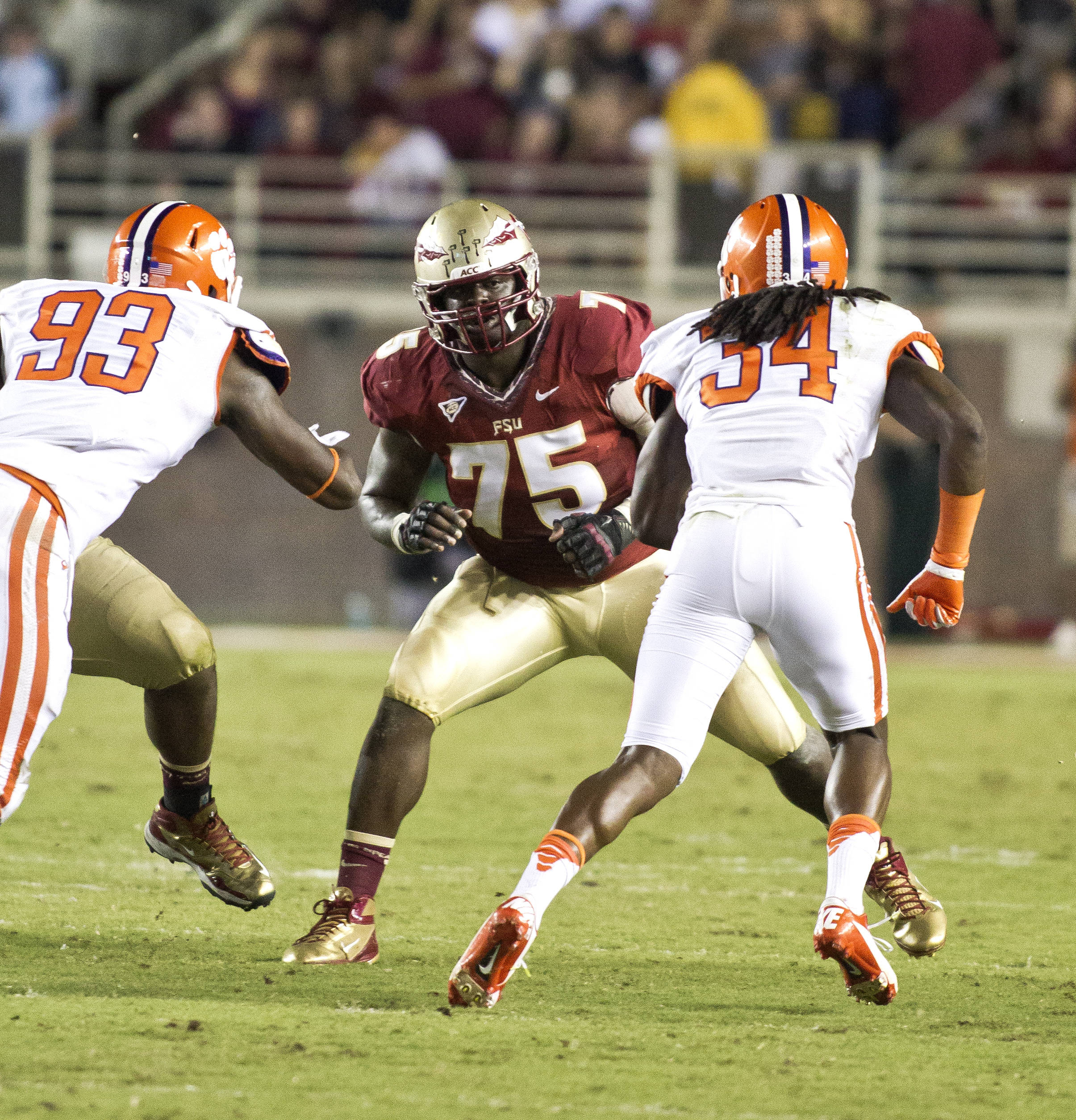 Cameron Erving (75) taking on two defensive players, FSU vs Clemson, 9/22/12 (Photo by Steve Musco)