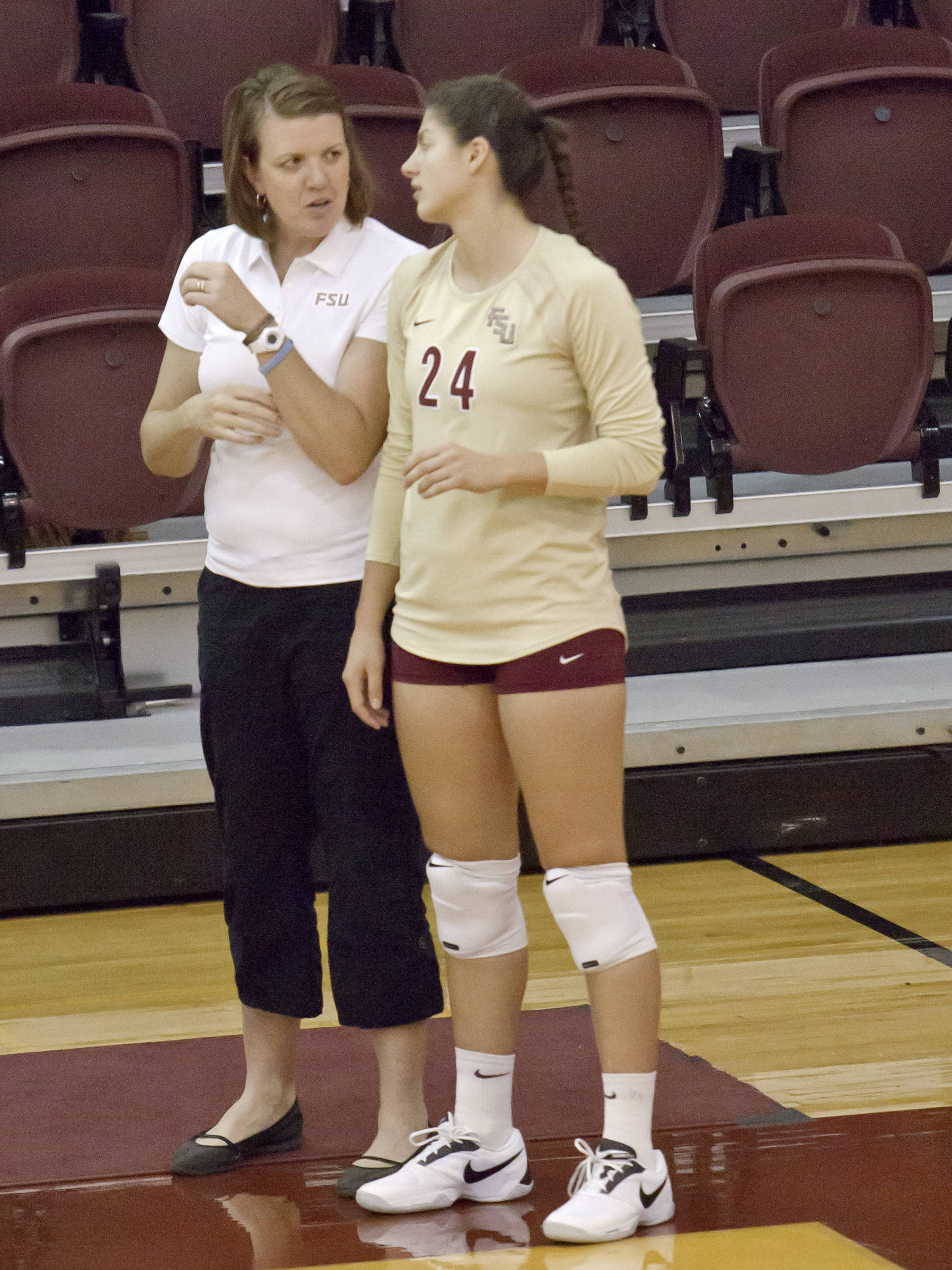 Associate Head Coach Holly Watts, Olivera Medic (24)