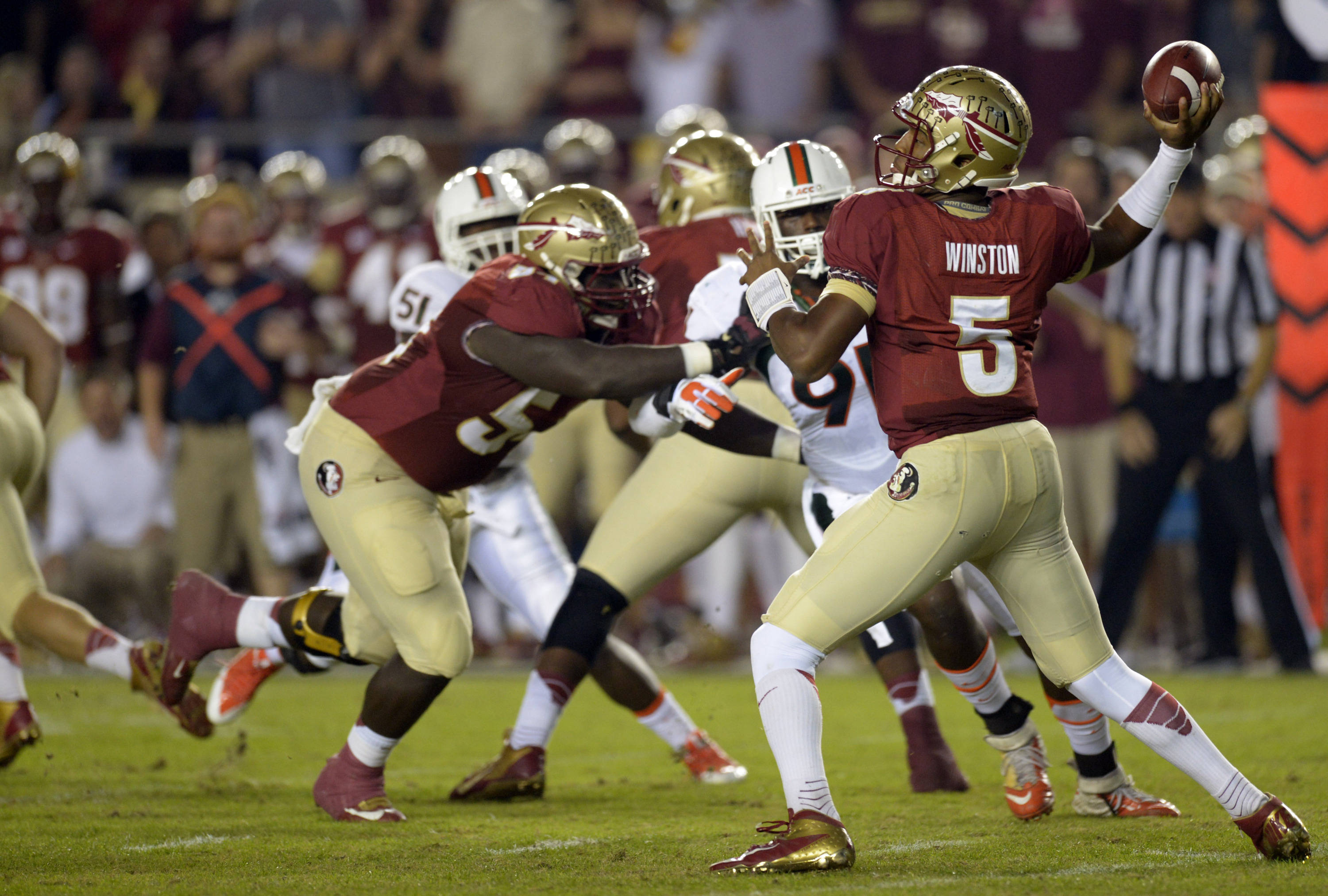 Florida State Seminoles quarterback Jameis Winston (5) passing against the Miami Hurricanes during the first quarter at Doak Campbell Stadium. Mandatory Credit: John David Mercer-USA TODAY Sports