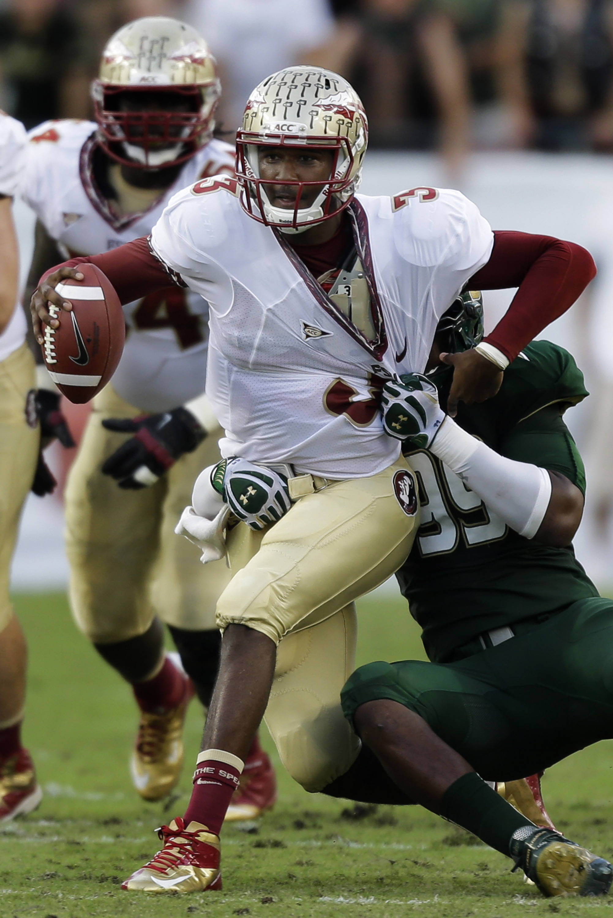 Florida State quarterback EJ Manuel (3) gets sacked by South Florida defensive lineman Tevin Mims (99) during the first quarter. (AP Photo/Chris O'Meara)