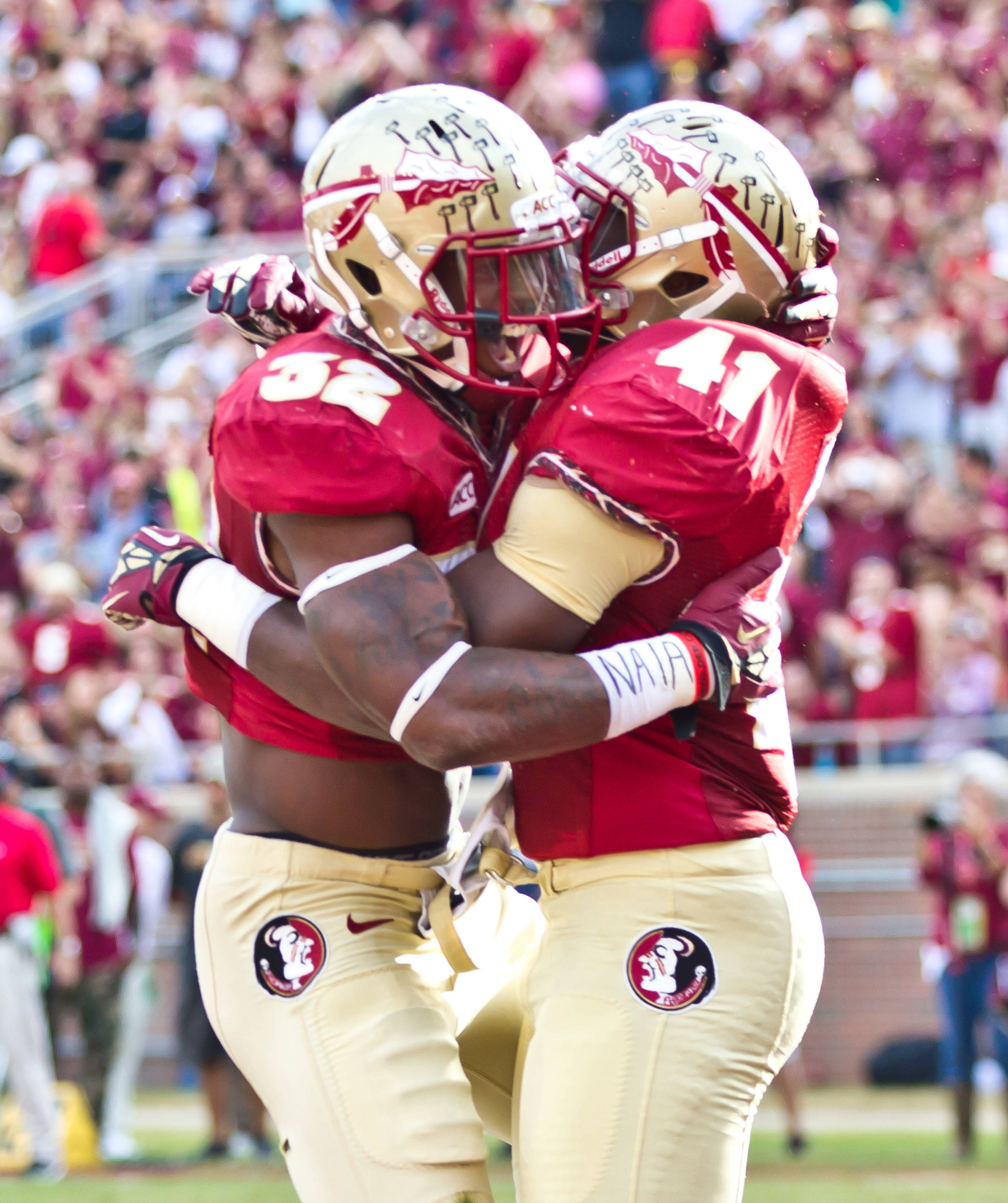 Chad Abram (41) and James Wilder, Jr. (32) celebrate Wilder's 1st quarter TD.