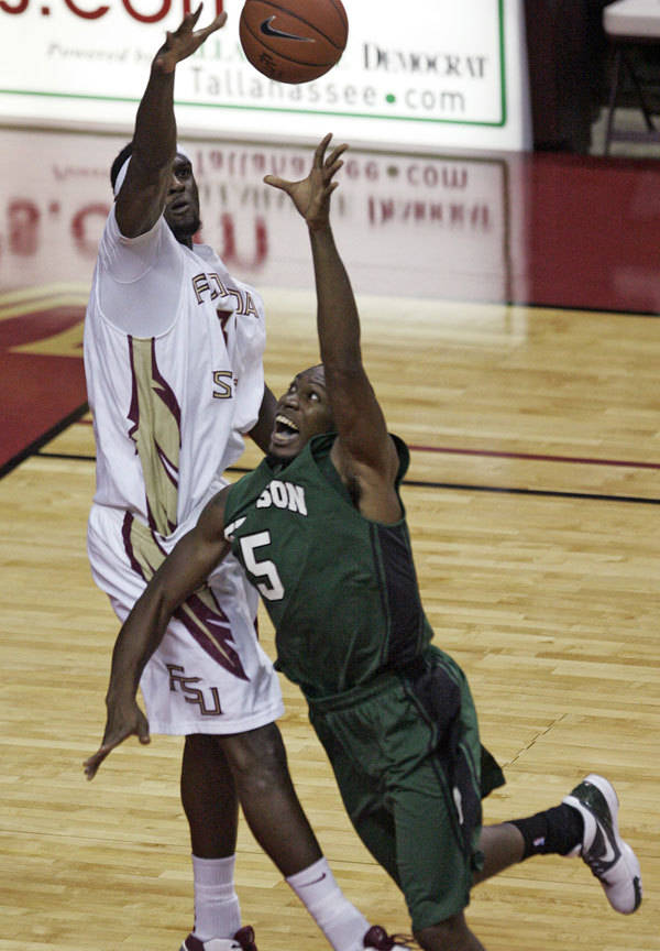 Florida State's Chris Singleton blocks the shot of Stetson's Ridge Graham in the first half.