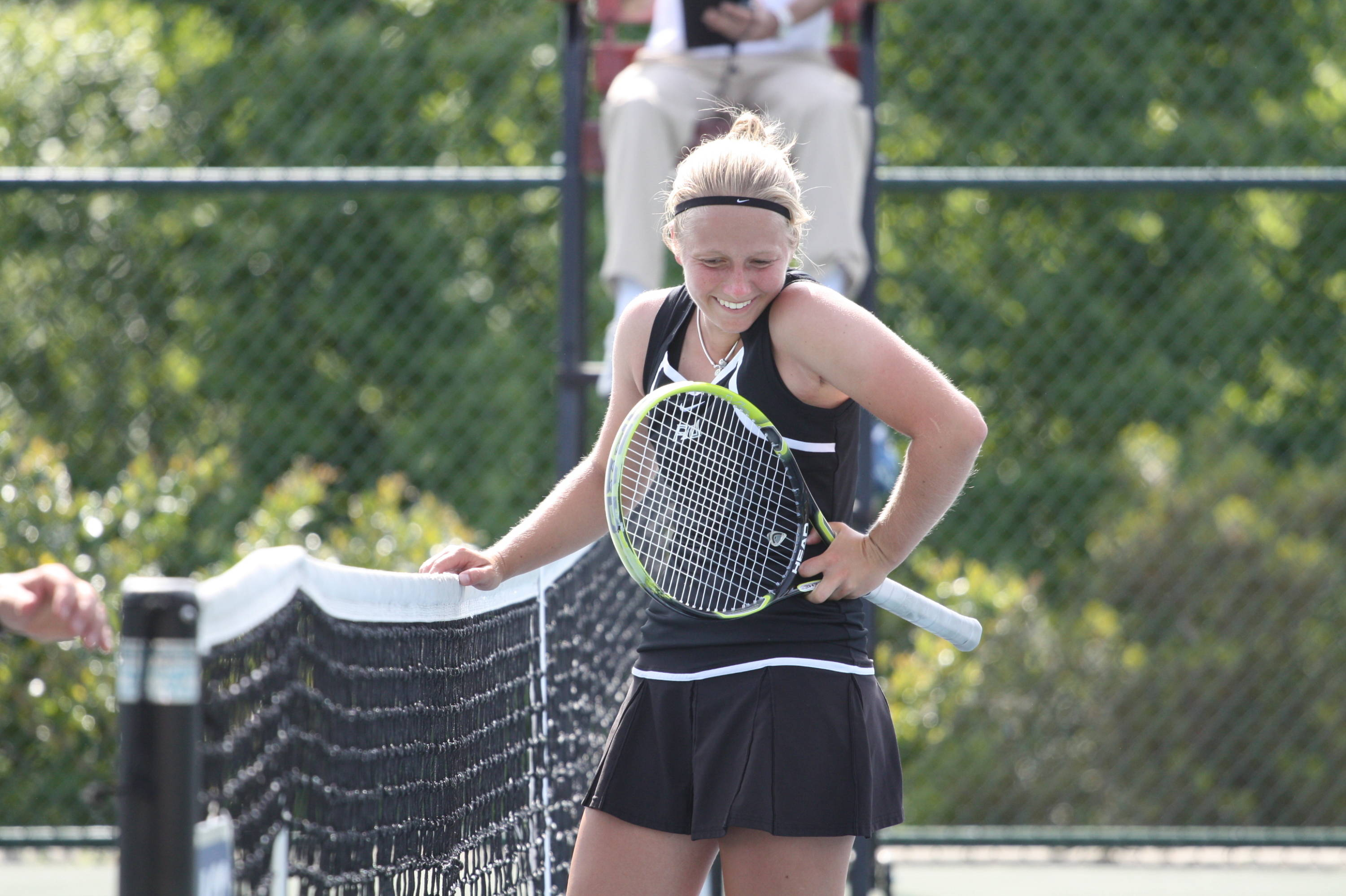 Kristina Schleich smiles at the net after coming back to win on court six against Clemson.