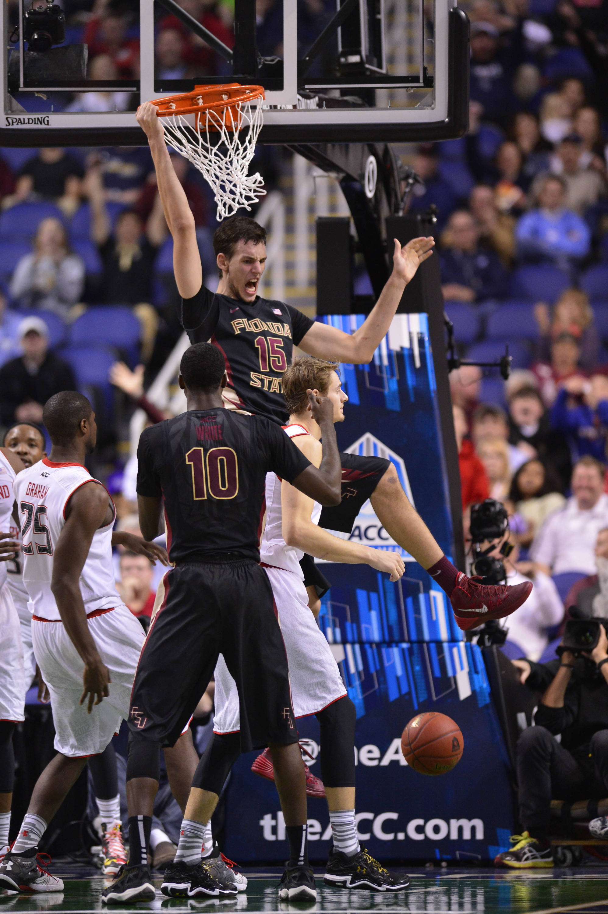 Florida State Seminoles center Boris Bojanovsky (15) hits the game winning shot. The Seminoles defeated the Terrapins 67-65 in the second round of the ACC college basketball tournament at Greensboro Coliseum. Mandatory Credit: Bob Donnan-USA TODAY Sports
