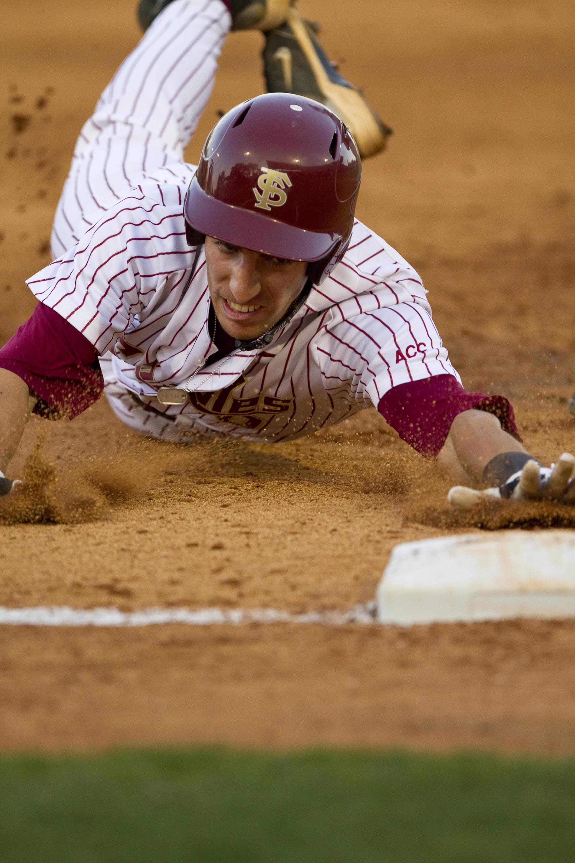 Justin Gonzalez (10) slides in to third.