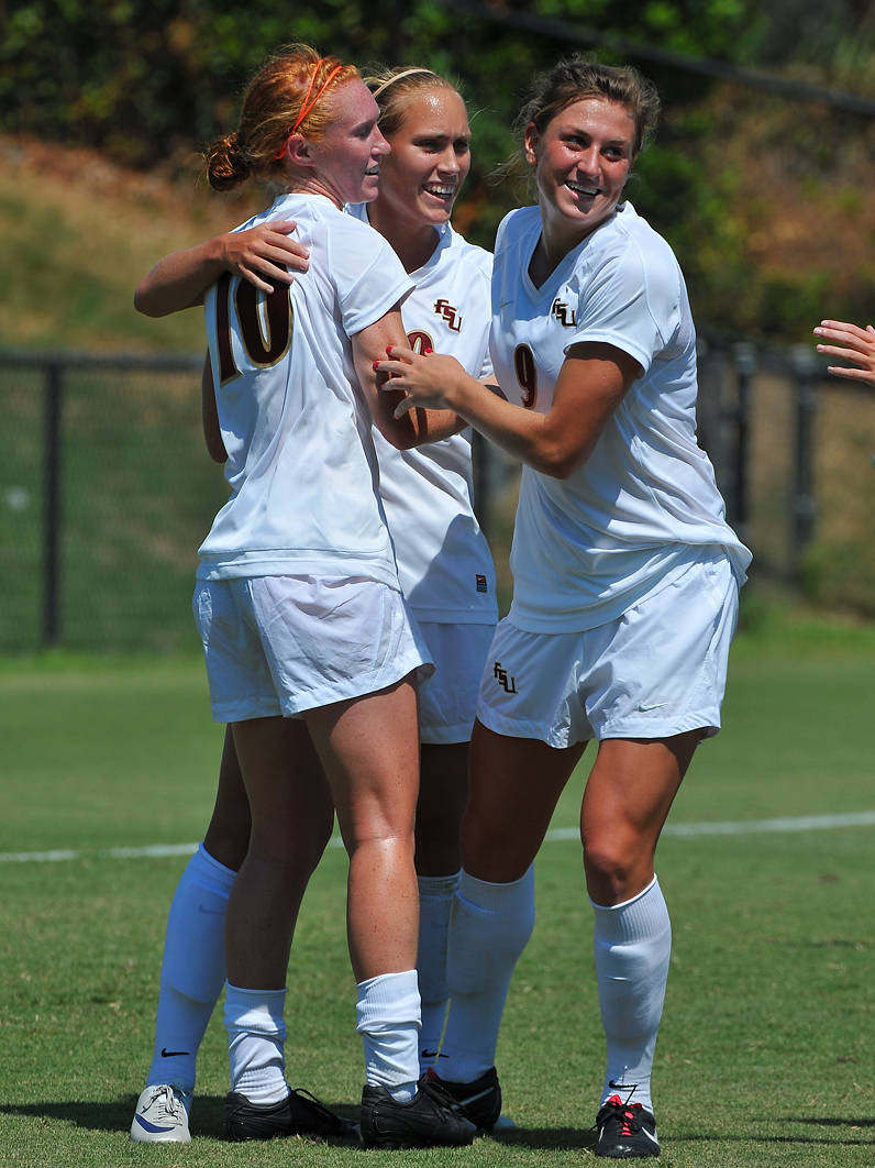 Tori Huster, Janice Cayman and Kassey Kallman celebrate after one of five FSU goals on Sunday.
