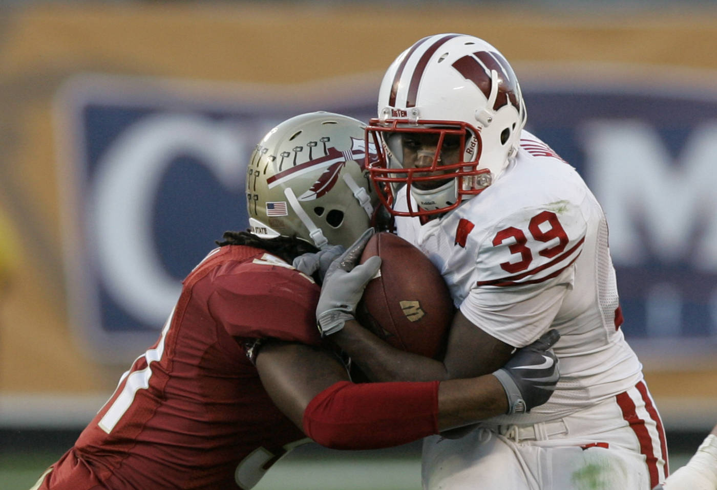 Wisconsin running back P.J. Hill (39) runs for yardage as he is tackled by Florida State linebacker Toddrick Verdell during the first half.(AP Photo/John Raoux)