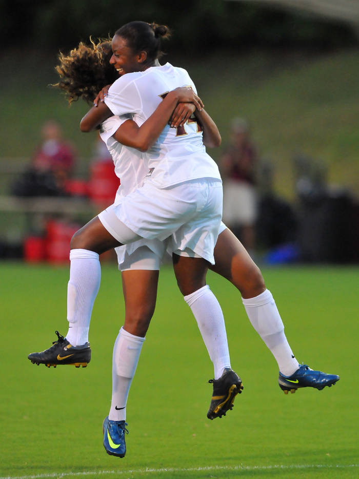 Tiffany McCarty and Casey Short celebrate following McCarty's goal to give FSU a 1-0 victory.