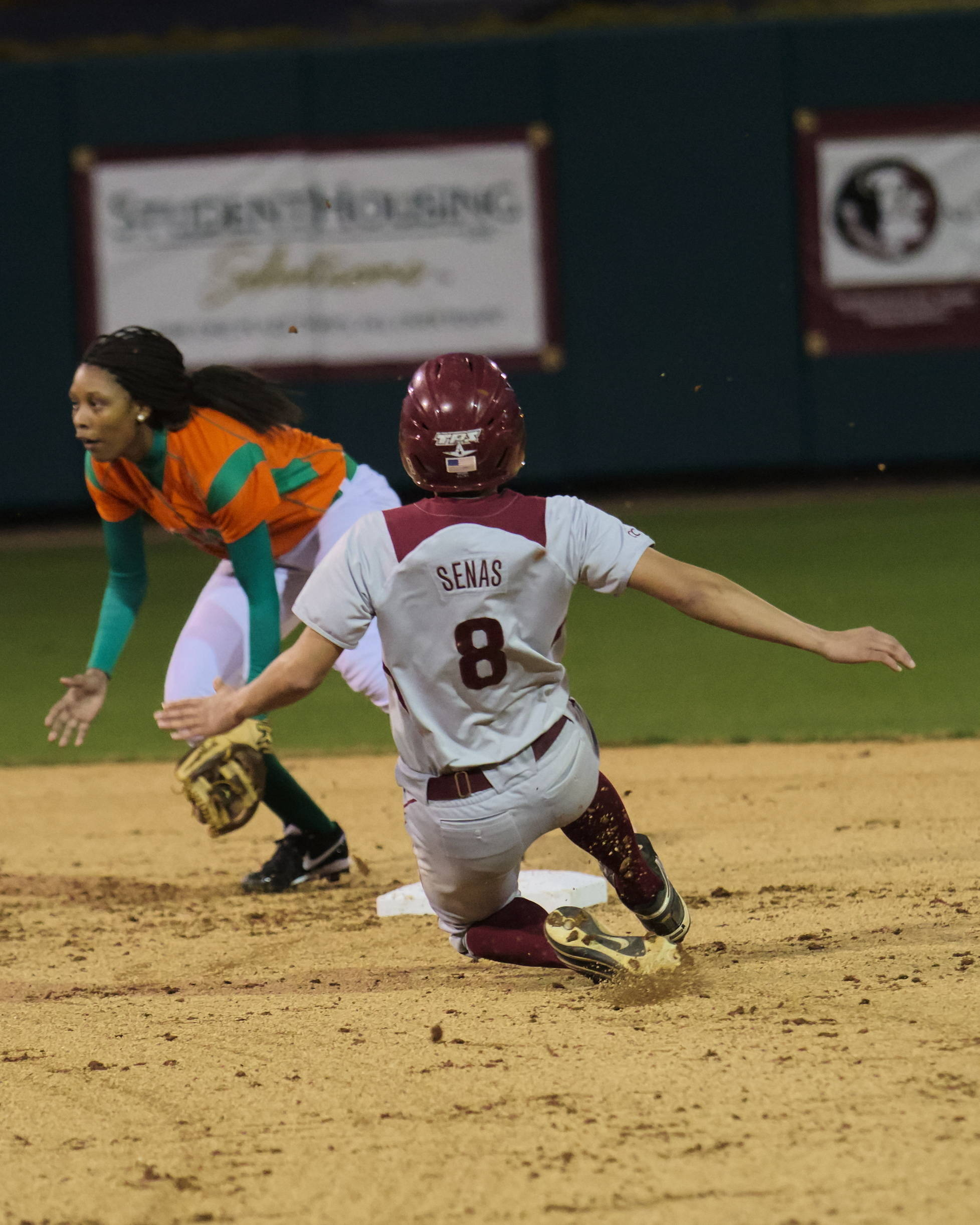 Courtney Senas (8), with a stolen base. FSU vs FAMU, 02/08/13. (Photo by Steve Musco)