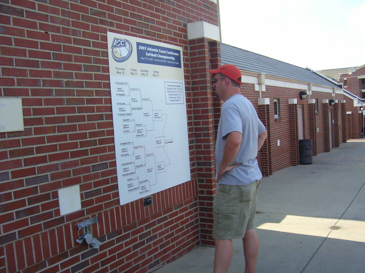 A fan checks out the scores of all the games on the tournament bracket.