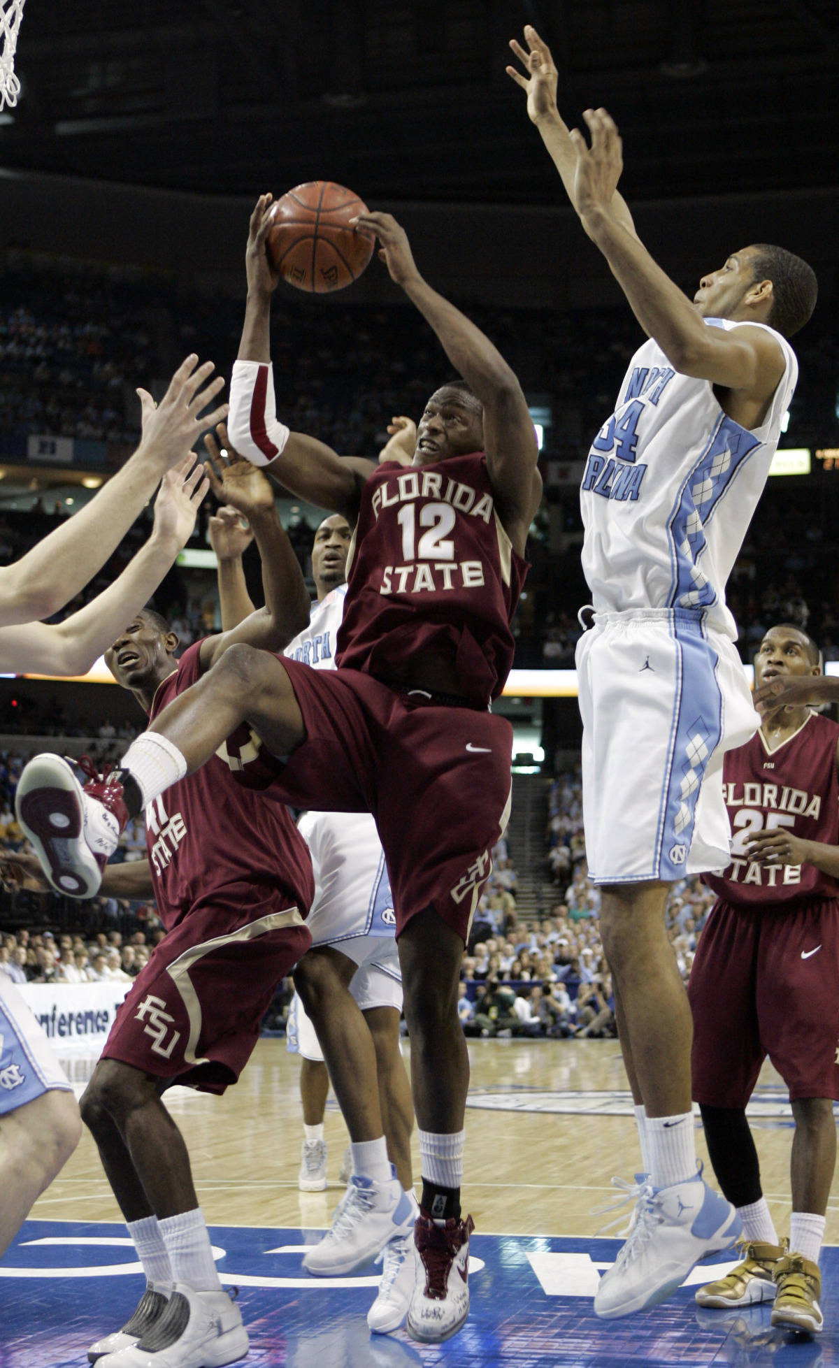 Florida State's Al Thornton (12) leaps for the basket under pressure from North Carolina's Brandan Wright (34) during a second round game of the Men's Atlantic Coast Conference basketball tournament in Tampa, Fla., Friday, March 9, 2007. (AP Photo/David J. Phillip)