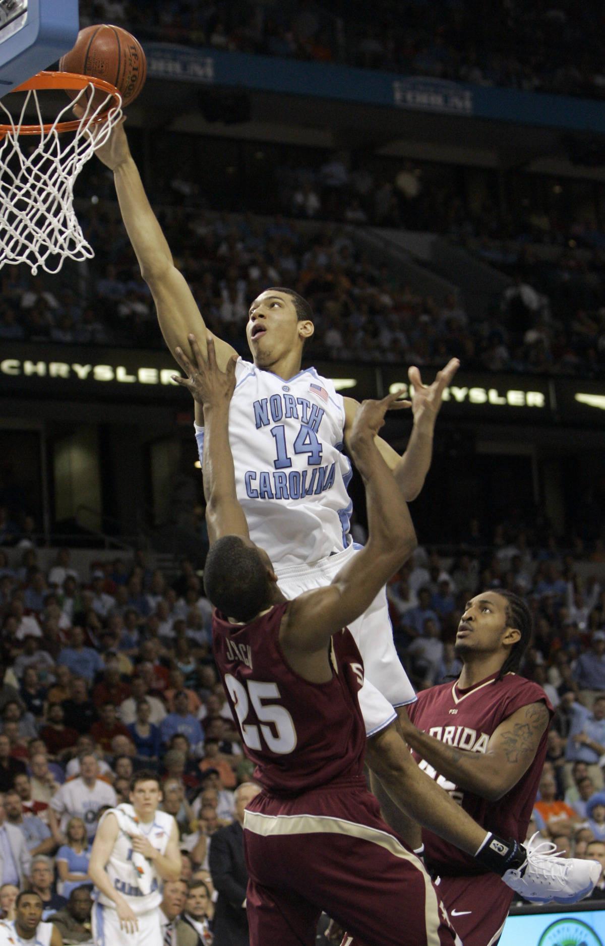 North Carolina's Danny Green (14) scores over Florida State's Jason Rich (24) and Ryan Rich (42) during a second round game of the Men's Atlantic Coast Conference basketball tournament in Tampa, Fla., Friday, March 9, 2007. North Carolina beat Florida State 73-58. (AP Photo/John Raoux)