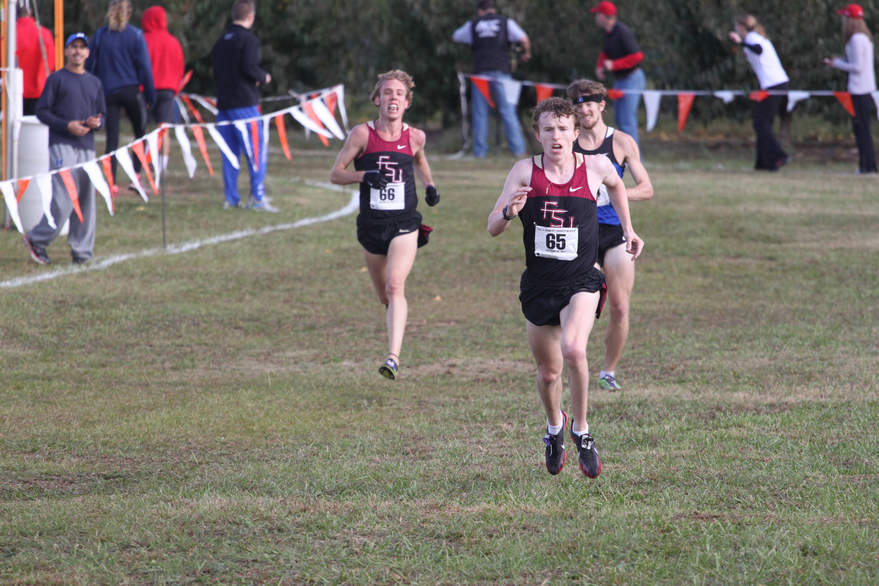 Breandan O Neill and Seth Proctor sprint to the finish at the ACC Championships