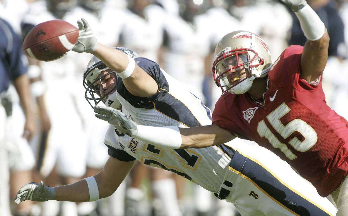 Rice receiver Andrew Novak, left, cannot make a second-quarter catch as Florida State's Tony Carter defends during an college football game, Saturday, Sept. 23, 2006, in Tallahassee, Fla.(AP Photo/Phil Coale)
