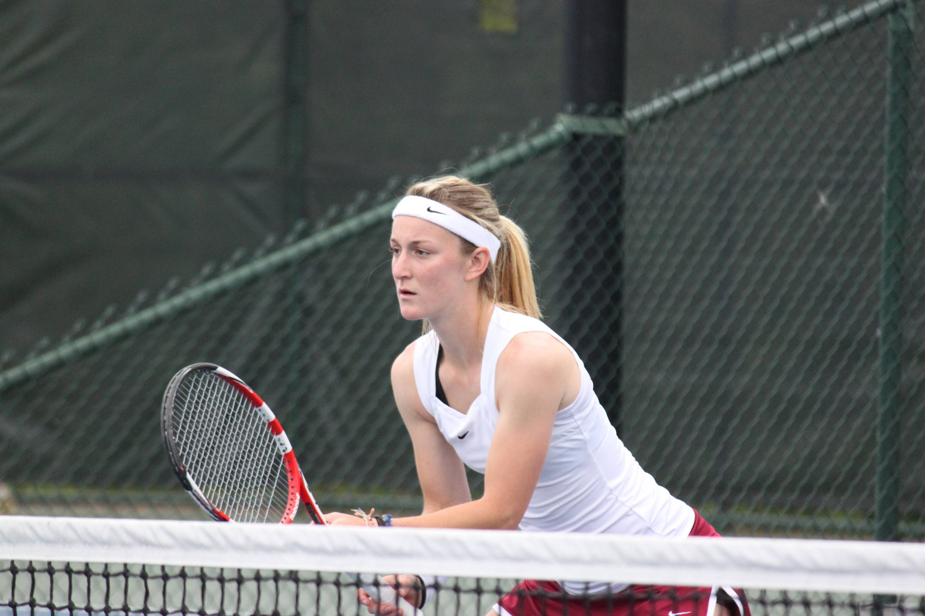 Ruth Seaborne at the net in doubles.