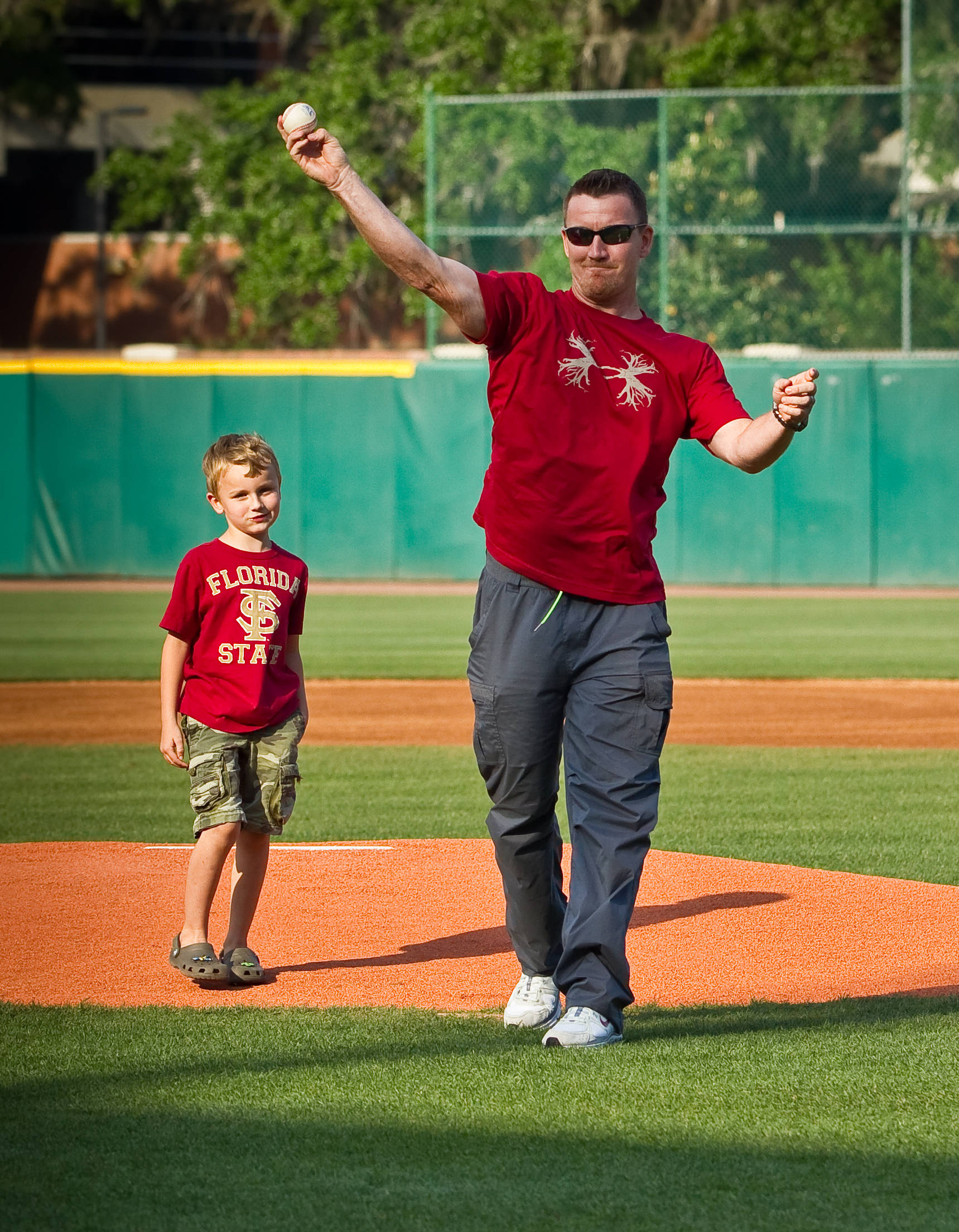 J.D. Drew and his son throw out the first pitch before the start of Tuesday's game against Florida.