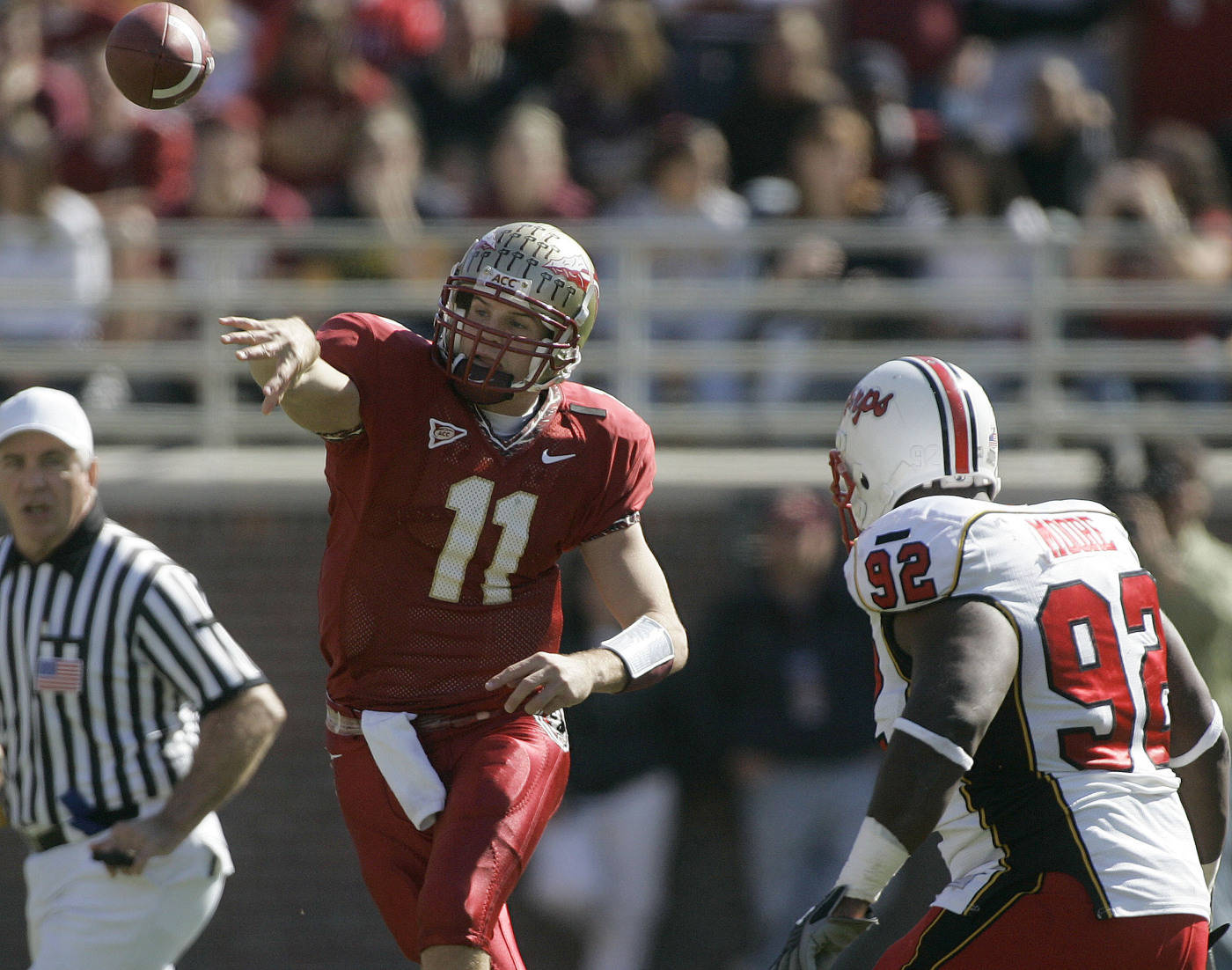 Florida State quarterback Drew Weatherford, left, throws a first quarter pass as Maryland's Dre Moore, right, gives chase.