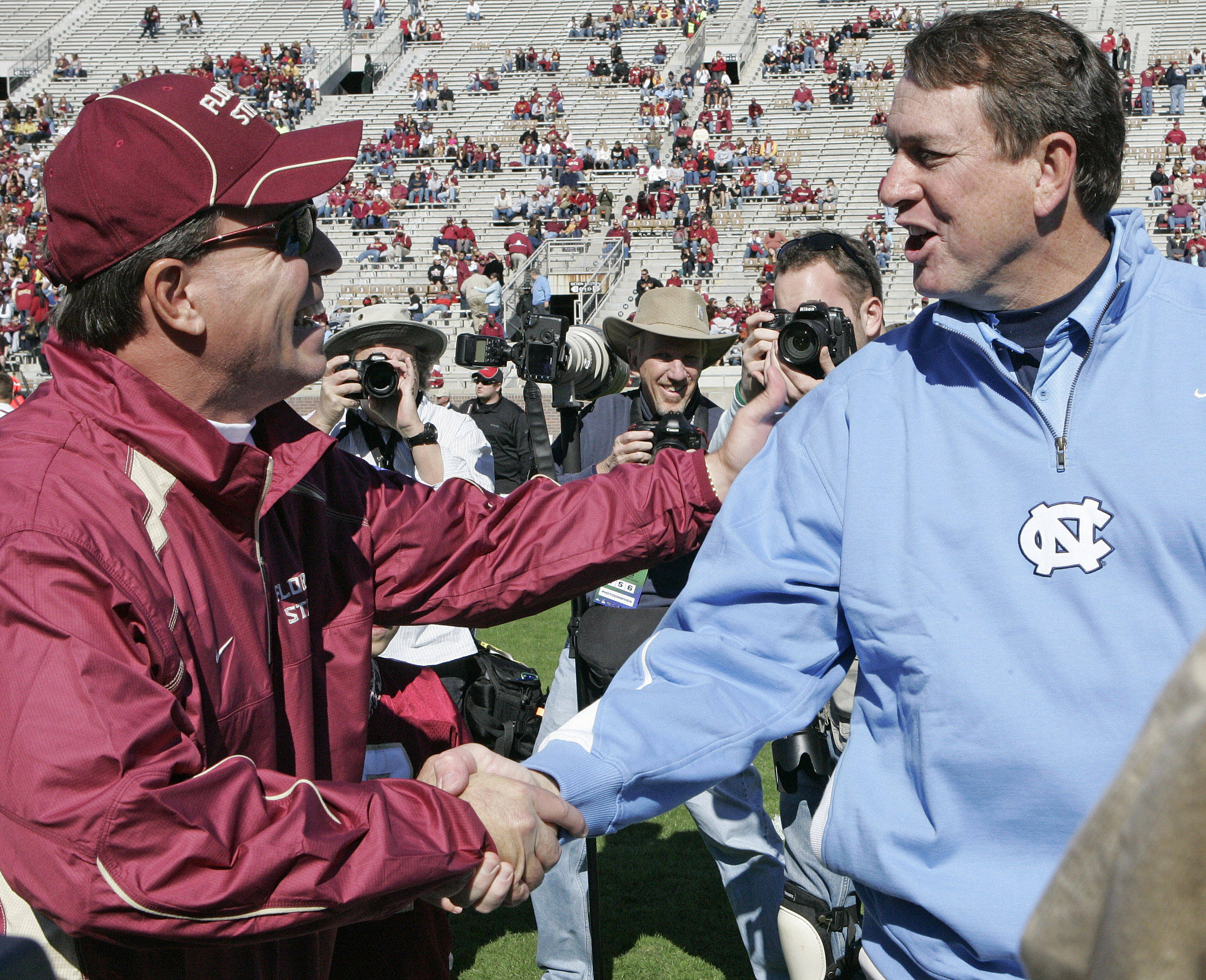 Florida State head coach Jimbo Fisher, left and North Carolina head coach Butch Davis wish each other good luck before the start of their showdown on Saturday. (AP Photo/Steve Cannon)