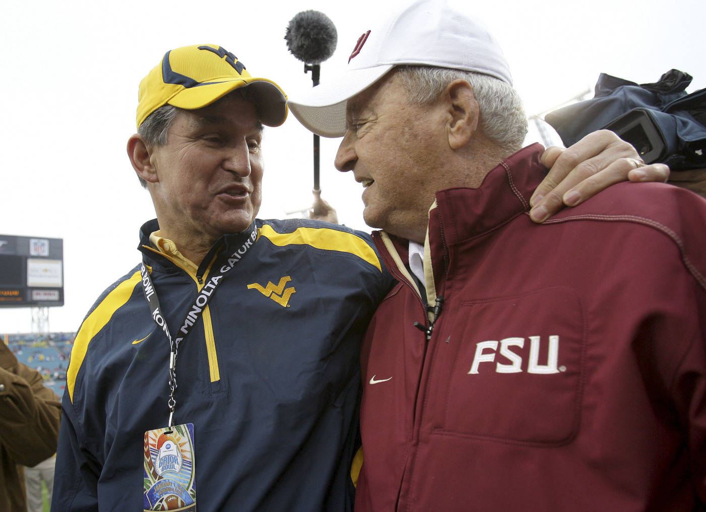 Florida State head coach, Bobby Bowden, right, meets with West Virginia Governor Joe Mansion prior the kickoff of the Gator Bowl NCAA college football game, Friday, Jan. 1, 2010, in Jacksonville, Fla.  Mansion was a former player of Bowden while Bowden coached at West Virginia. (AP Photo/Phil Coale)