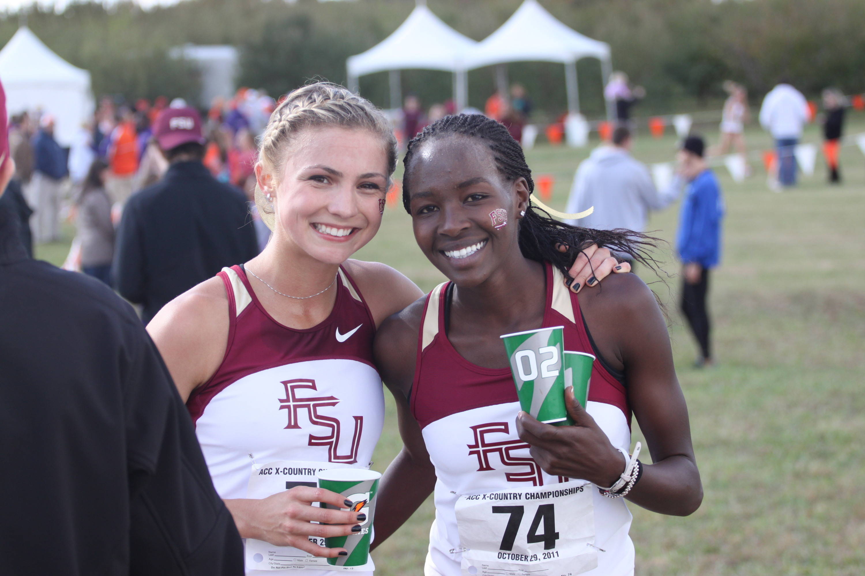 Jessica Parry and Violah Lagat flash big smiles after FSU's fourth consecutive ACC XC title in 2011