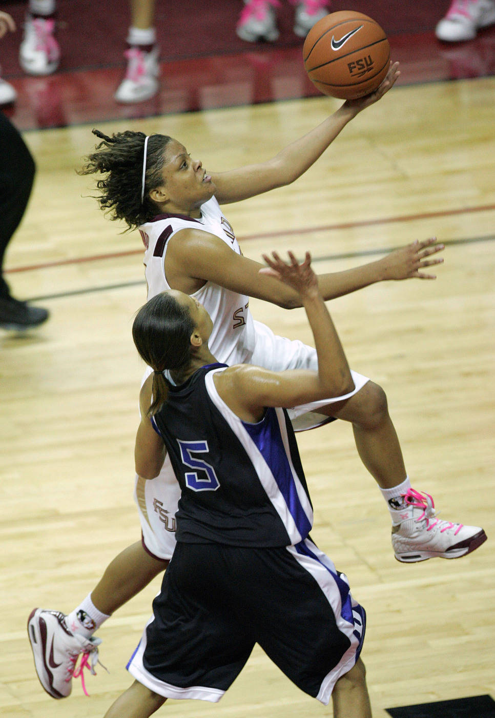 Florida State's Courtney Ward, top, drives past Duke's Jasmine Thomas for two second-half points during an NCAA college basketball game, Thursday, Jan. 29, 2009, in Tallahassee, Fla. Florida State won in overtime 82-75. (AP Photo/Phil Coale)
