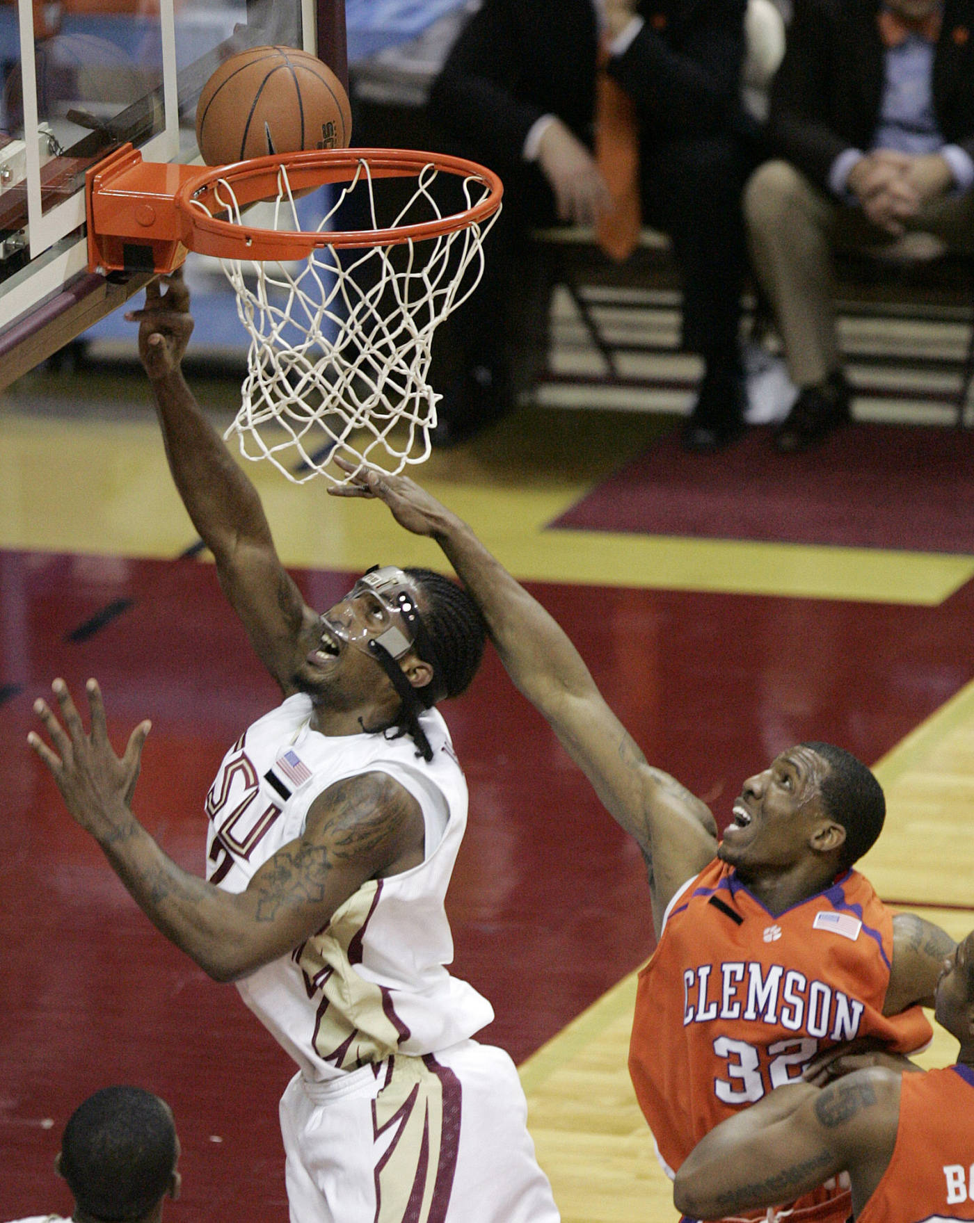 Florida State's Ryan Reid gets past the defense Clemson's Sam Perry to get off a shot in the first half of a basketball game Tuesday, Feb. 19, 2008, in Tallahassee, Fla. (AP Photo/Steve Cannon)