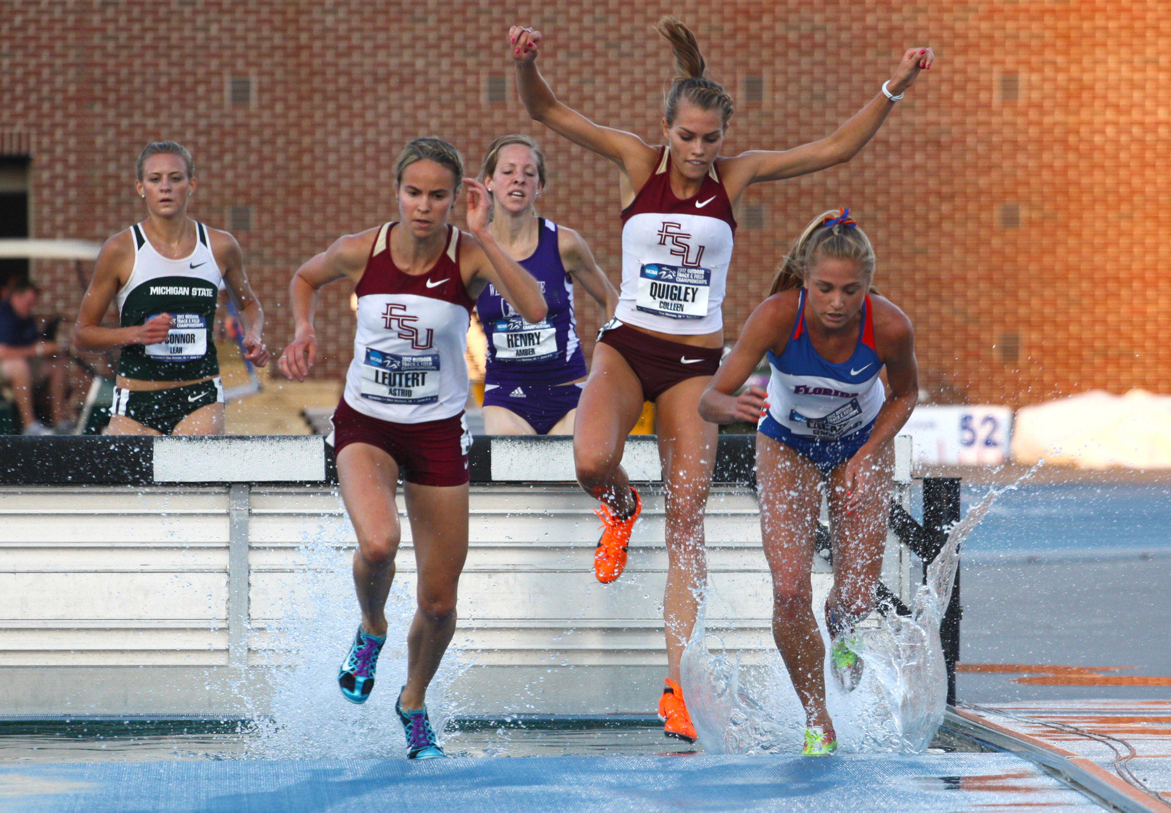Astrid Leutert leads the way with Colleen Quigley close behind in the late stages of the steeplechase