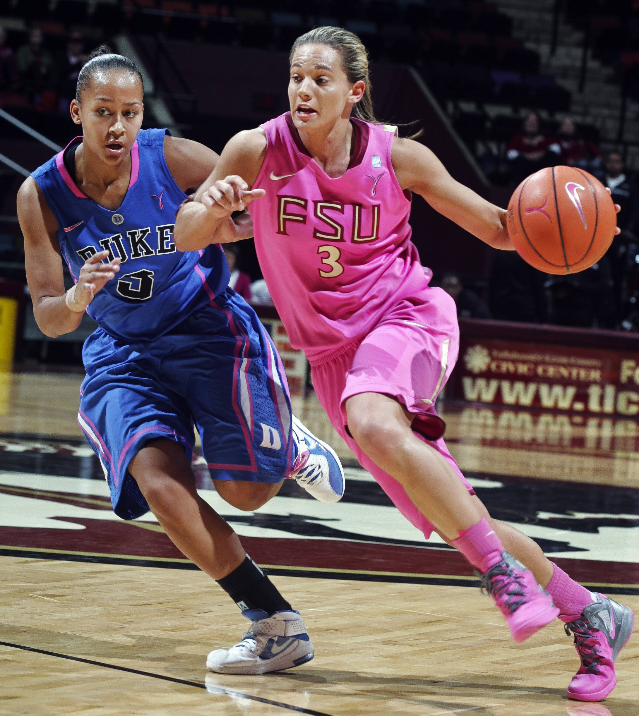 Florida State's Alexa Deluzio (3) drives around Duke's Shay Selby, left. (AP Photo/Phil Sears)