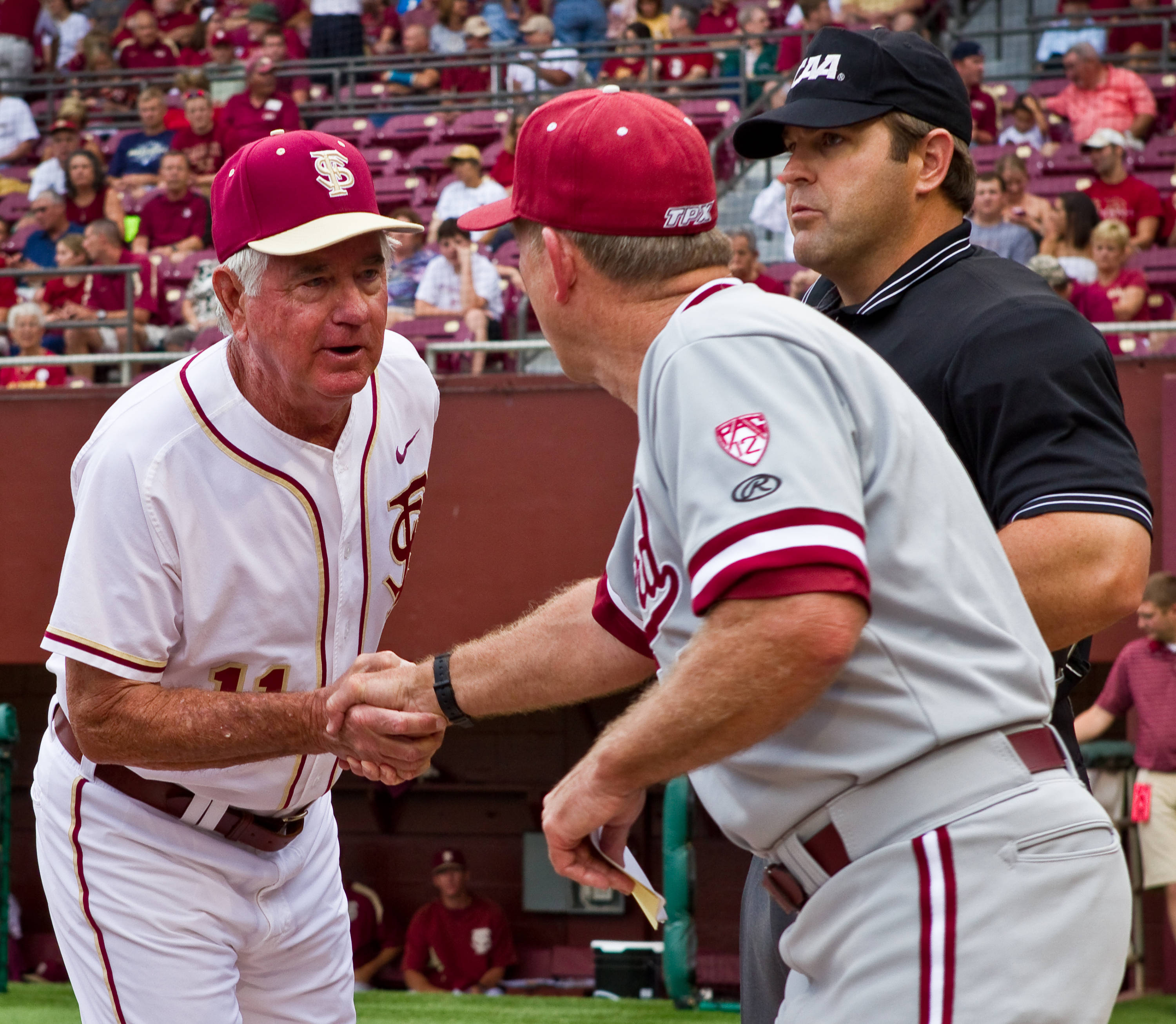 Mike Martin and Mark Marquess shake hands prior to the start of game one.