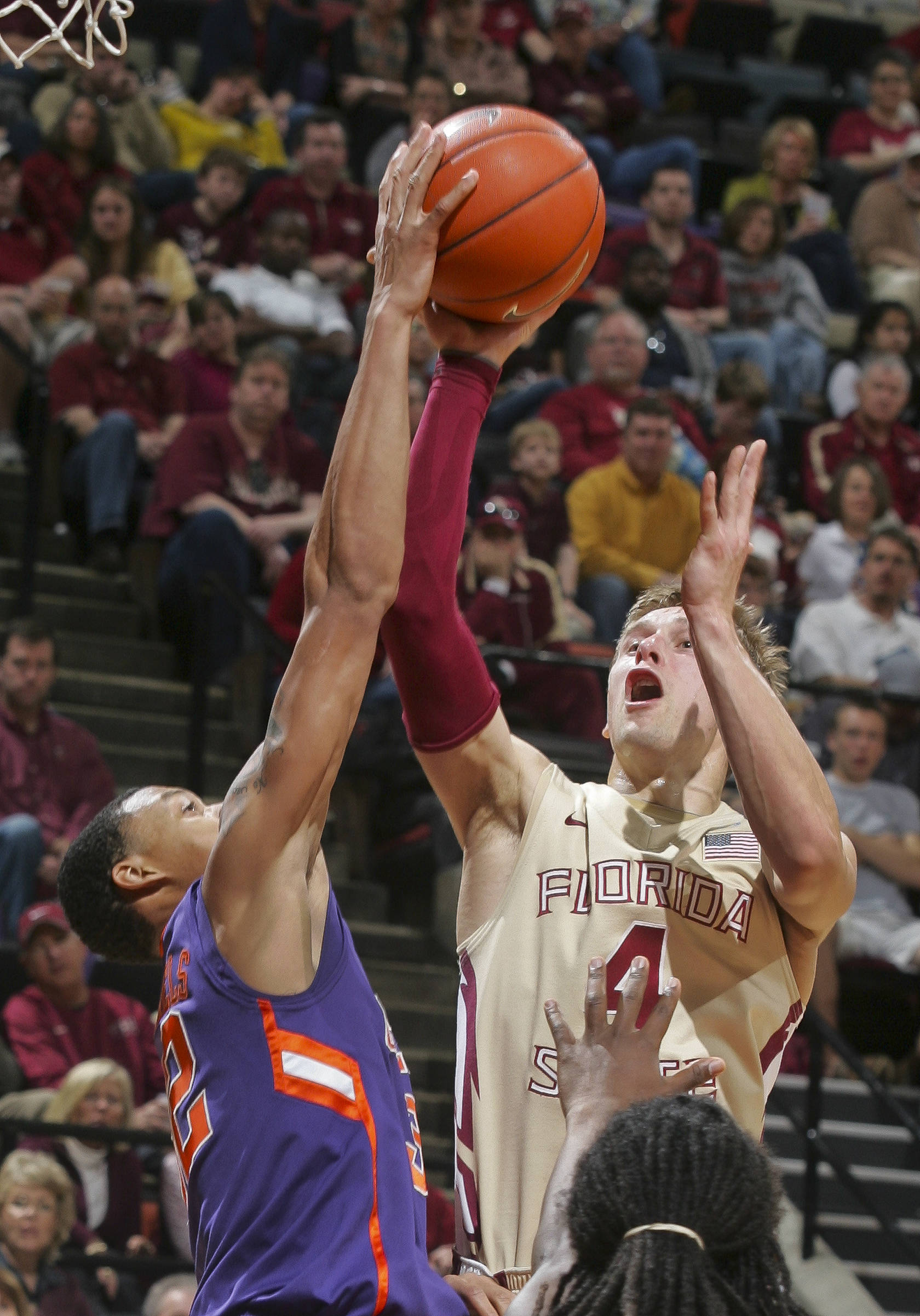 Florida State's Deividas Dulkys (4) goes up for a shot against Clemson guard K.J. McDaniels (32) in the second half. (AP Photo/Phil Sears)