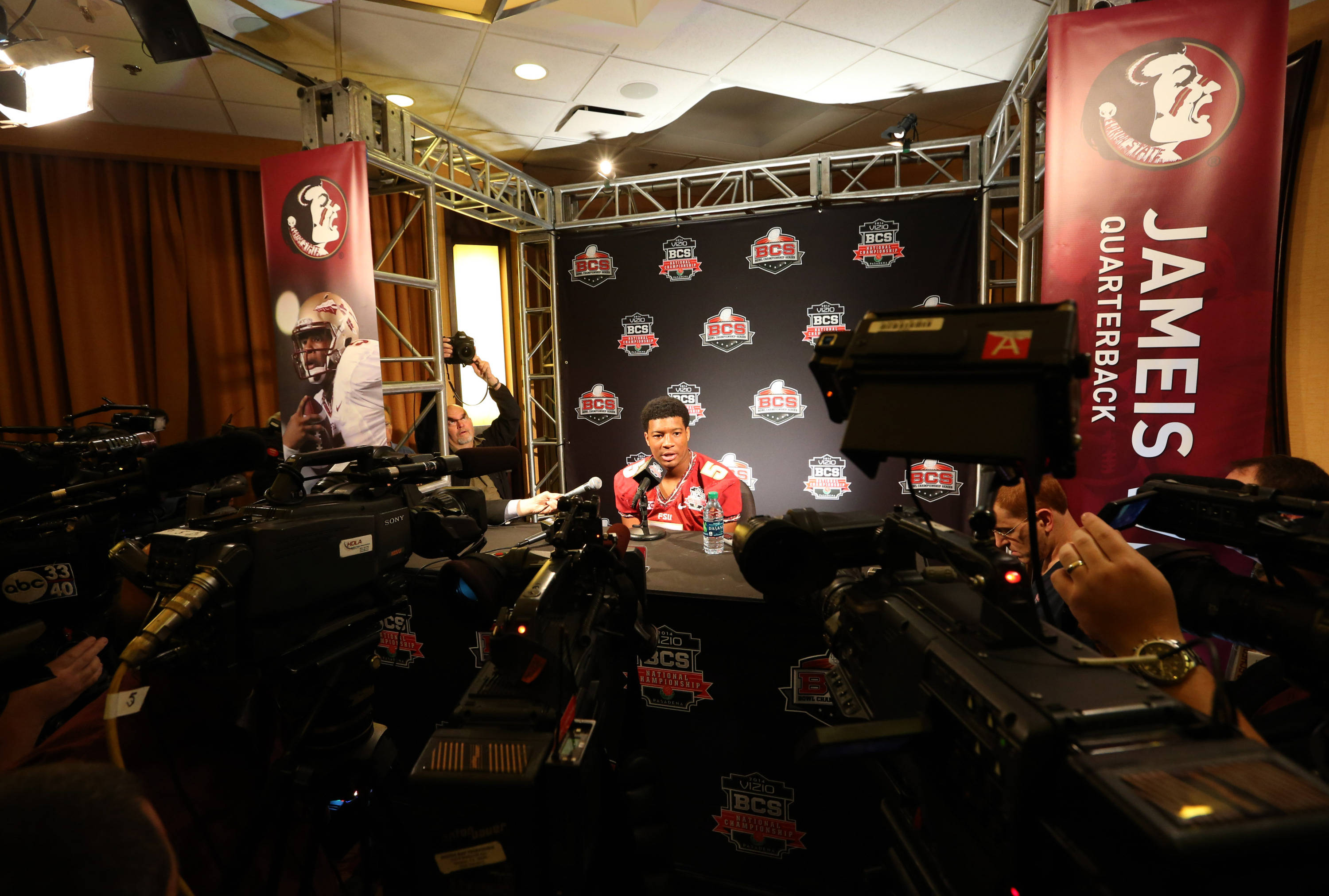 Jan 4, 2014; Newport Beach, CA, USA; Seminoles quarterback Jameis Winston (5) smiles as he answers questions during Media Day at Newport Beach Marriott. Matthew Emmons-USA TODAY Sports