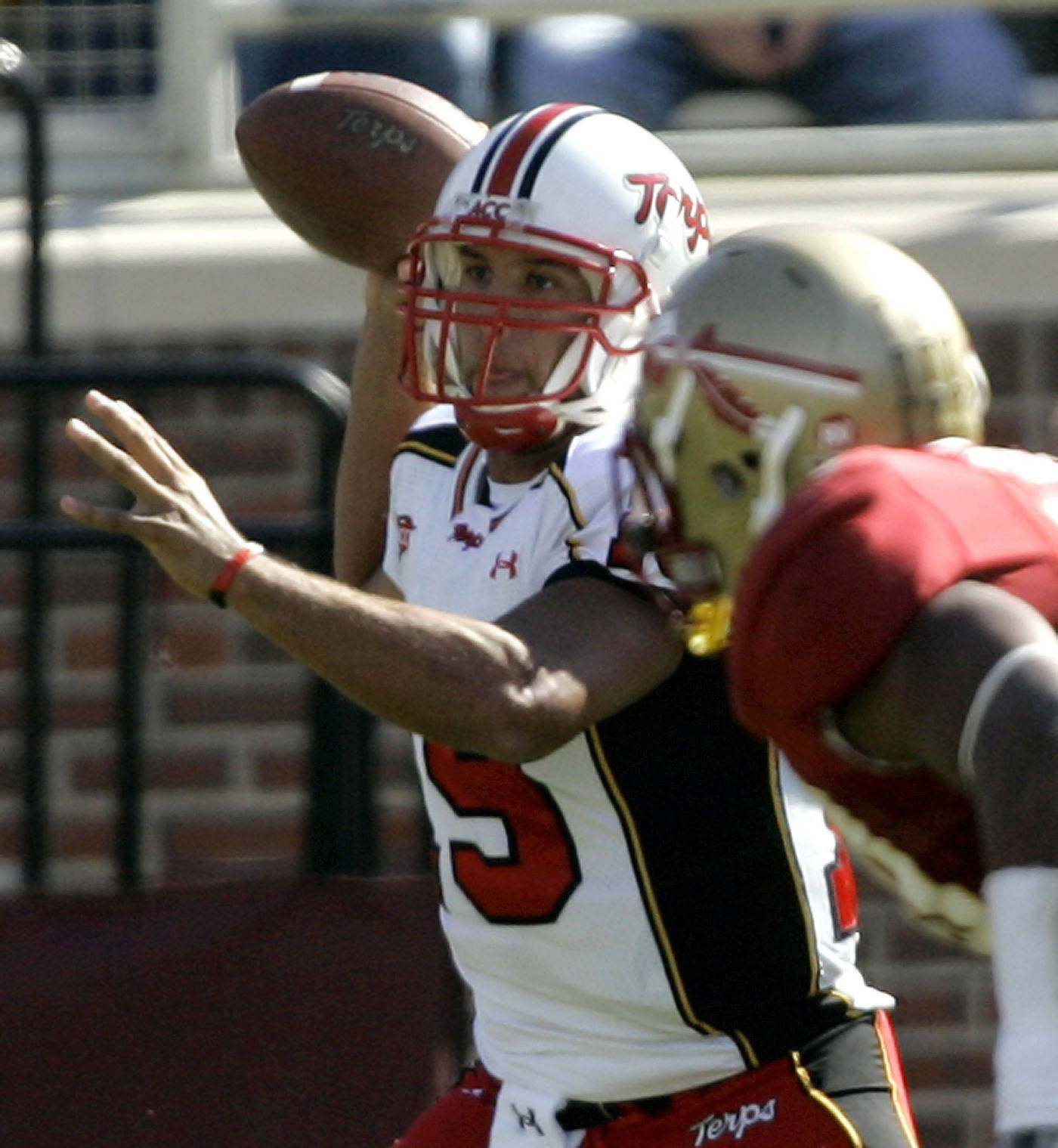 Maryland quarterback Jordan Steffy, left, looks for a receiver in the seond quarter.