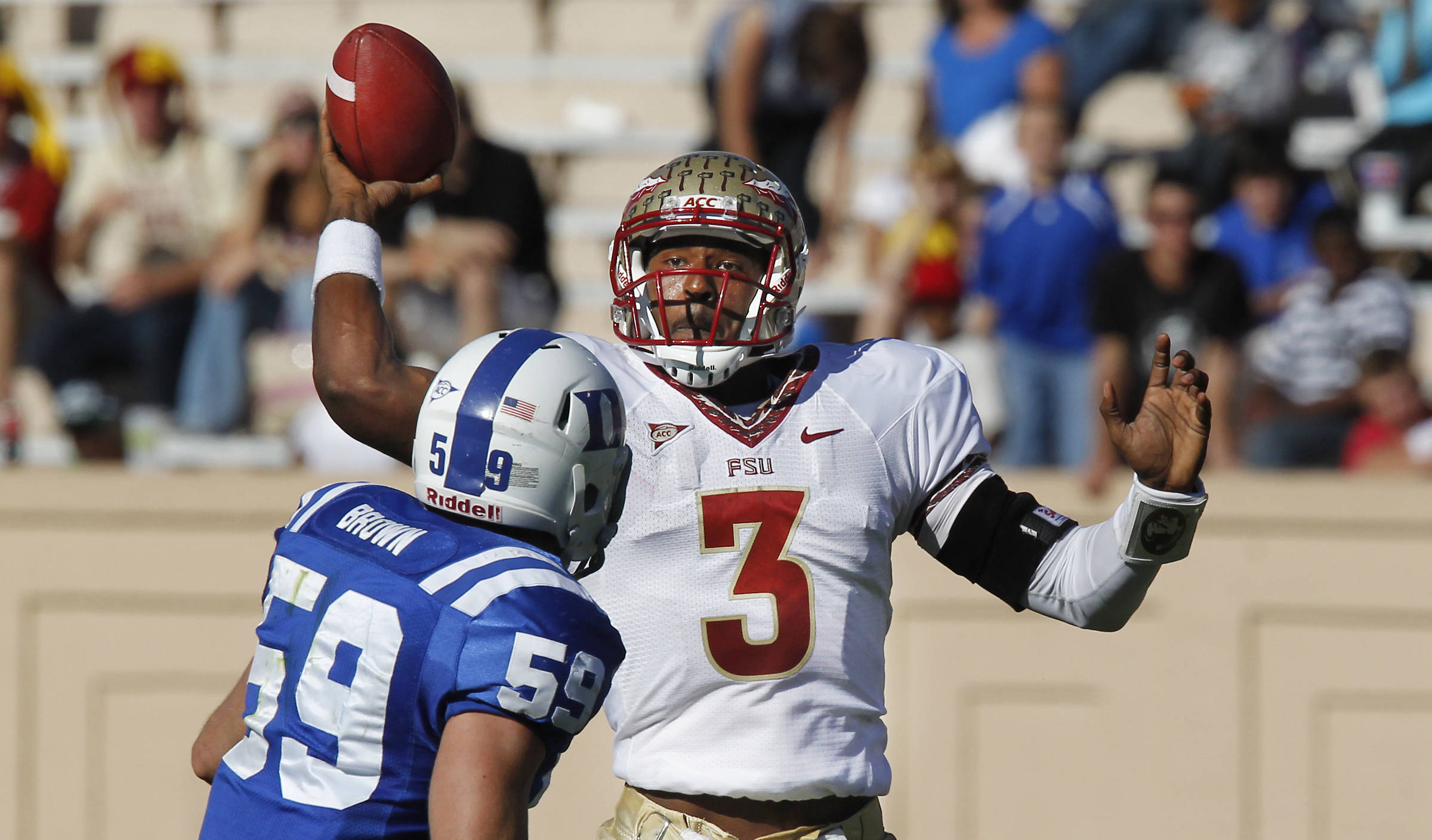 Florida State quarterback EJ Manuel (3) looks to pass as Duke linebacker Kelby Brown (59) defends. (AP Photo/The News & Observer, Chuck Liddy)