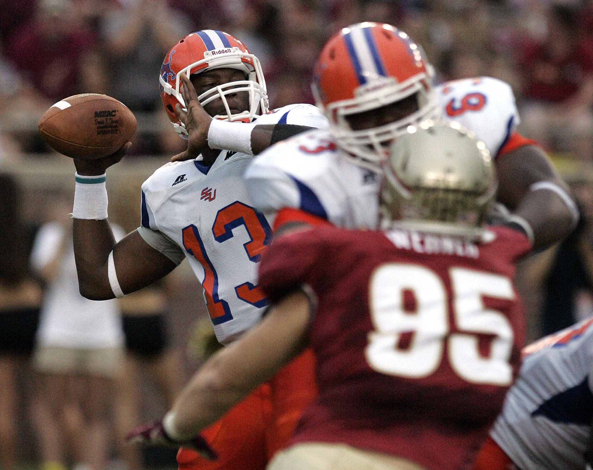 Savannah State's Antonio Bostick, left, looks downfield as he attempts a pass in the first quarter. (AP Photo/Steve Cannon)