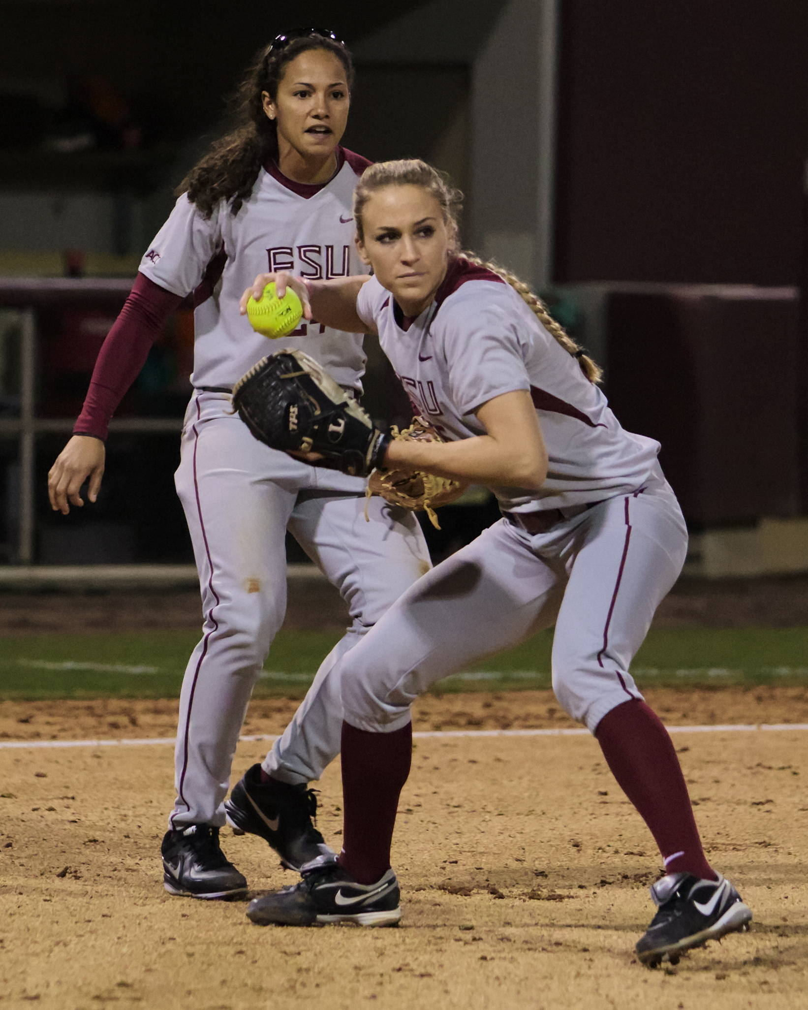 Monica Perry (55) fielding a bunt, FSU vs FAMU, 02/08/13. (Photo by Steve Musco)