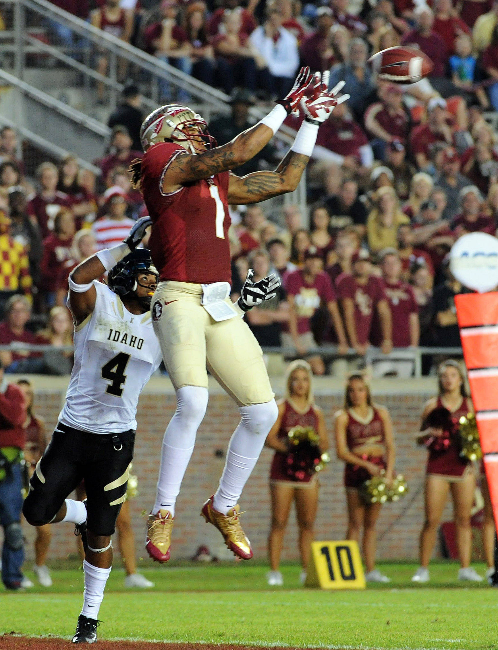 Kelvin Benjamin (1) catches a touchdown over Idaho Vandals cornerback Jayshawn Jordan (4). Mandatory Credit: Melina Vastola-USA TODAY Sports