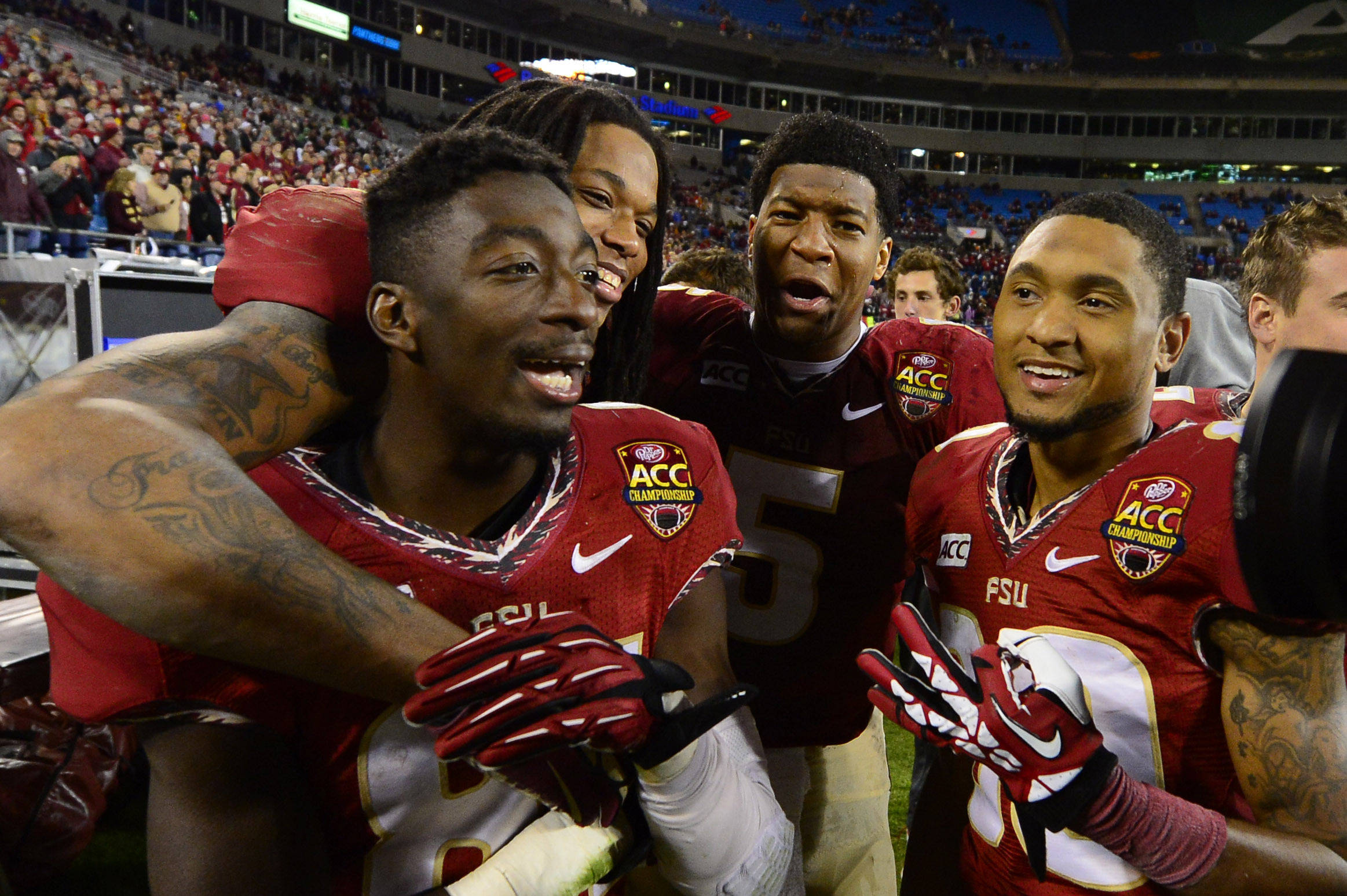 Dec 7, 2013; Charlotte, NC, USA; Florida State Seminoles wide receivers Kenny Shaw (81) and Kelvin Benjamin (1) and quarterback Jameis Winston (5) and  wide receiver Rashad Greene (80) react at the end of the game. The Seminoles defeated the Blue Devils 45-7 at Bank of America Stadium. Mandatory Credit: Bob Donnan-USA TODAY Sports