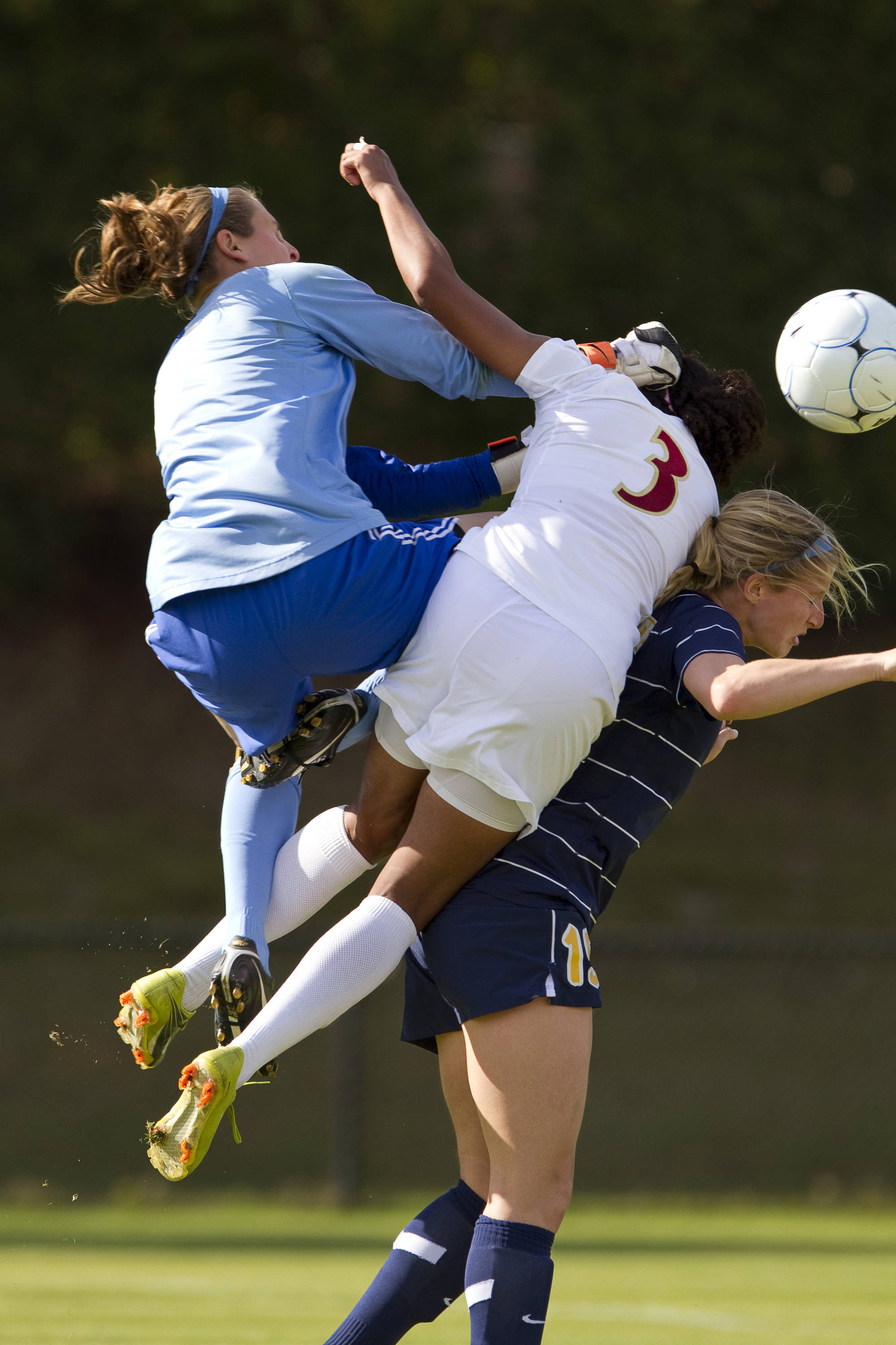 Casey Short (3) challenges Marquette's keeper for the ball.