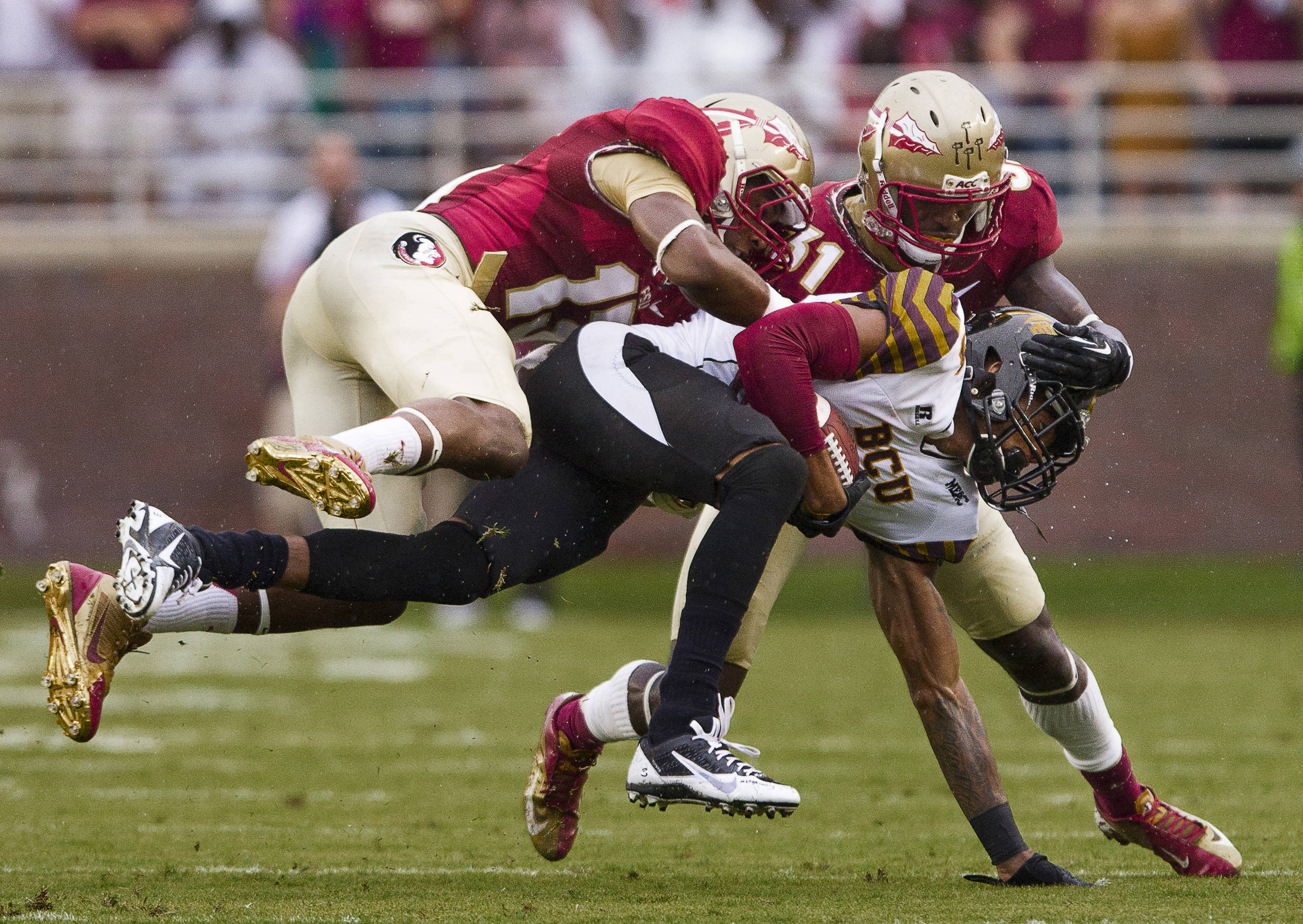Jalen Ramsey (13) and Terrence Brooks (31) tackle a ball carrier during FSU Football's 54-6 win over Bethune-Cookman on September 21, 2013 in Tallahassee, Fla Jalen Ramsey (13)