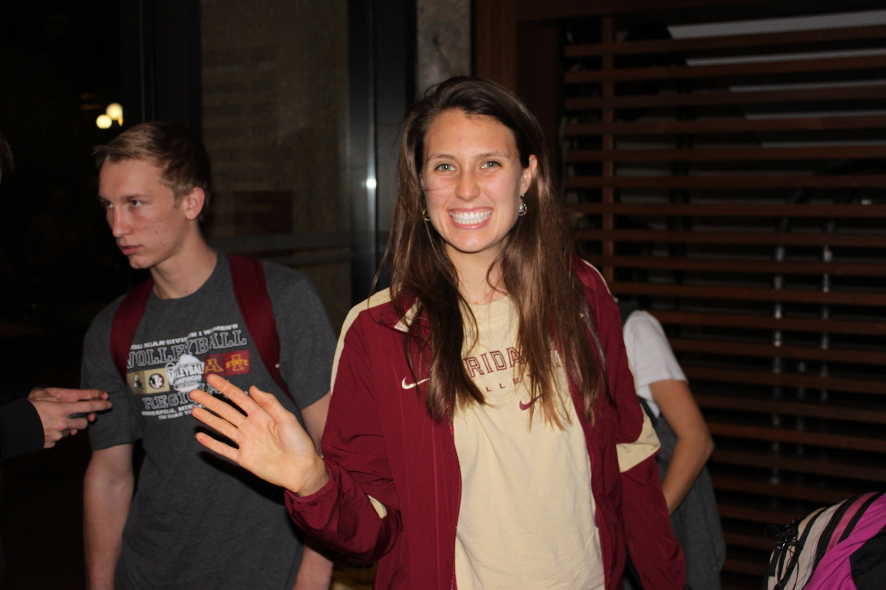 Amanda Saxton (15) smiles for the camera as she arrives at the team hotel