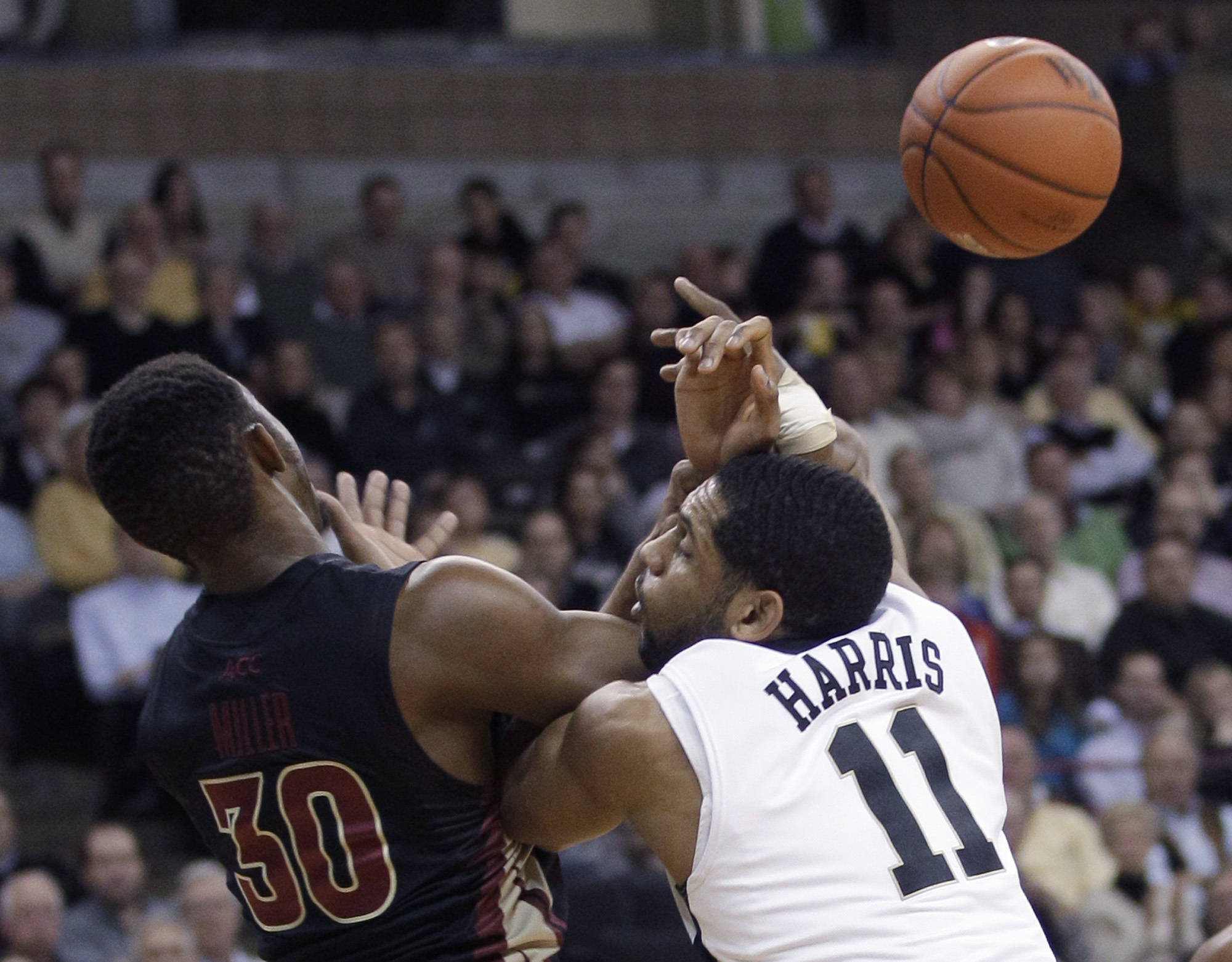 Wake Forest's C.J. Harris (11) and Ian Miller battle for a rebound. (AP Photo/Chuck Burton)