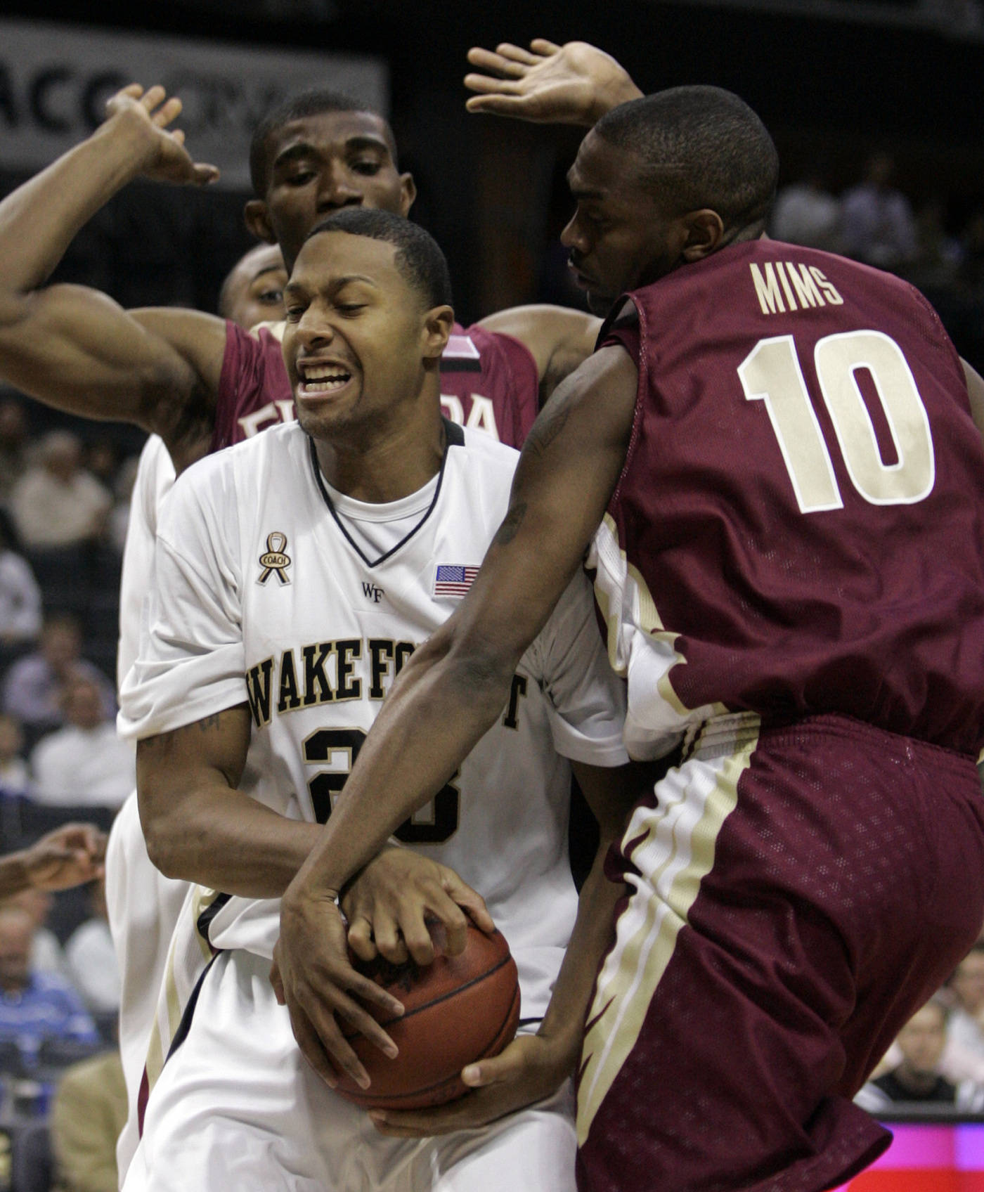Wake Forest's James Johnson fights for the ball as he is double teamed byUche Echefu, rear, and Ralph Mims (10) in the first half of their ACC basketball tournament game at Bobcats Arena in Charlotte, N.C., Thursday. (AP Photo/Steve Helber)