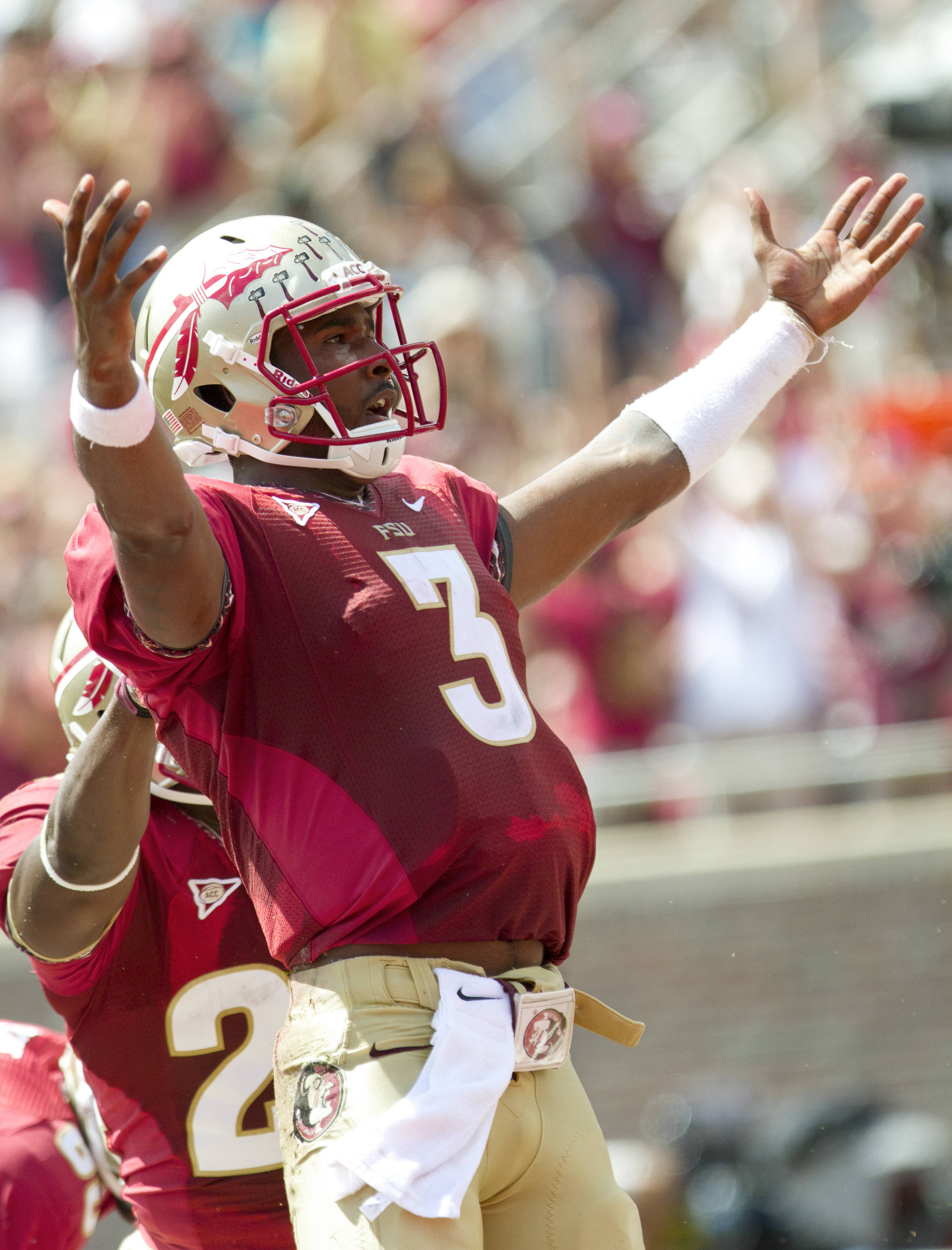 EJ Manuel (3) celebrates after scoring the first touchdown of the game.