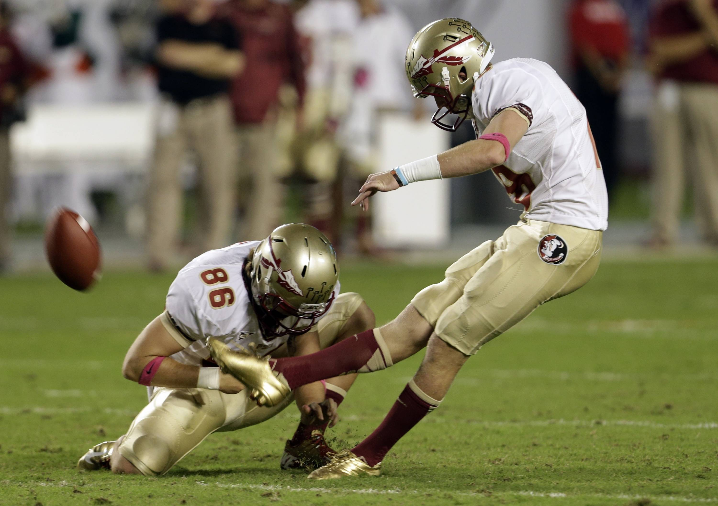 Florida State's Dustin Hopkins, right, kicks a field goal from the hold of Chris Revell (86) during the first half of an NCAA college football game against Miami, Saturday, Oct. 20, 2012, in Miami. (AP Photo/Lynne Sladky)