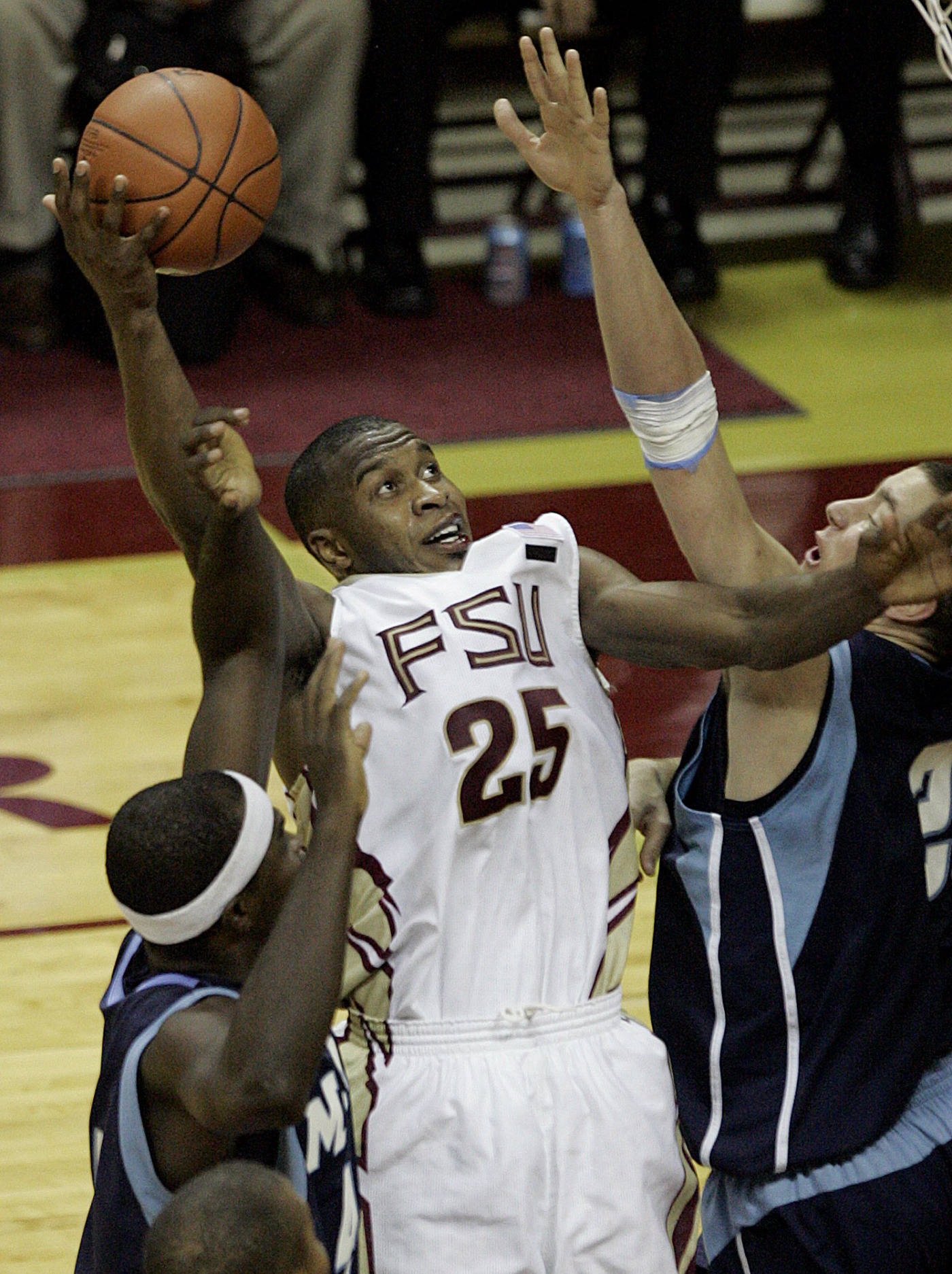 Florida State's Jason Rich is fouled in a shot attempt in the second half.