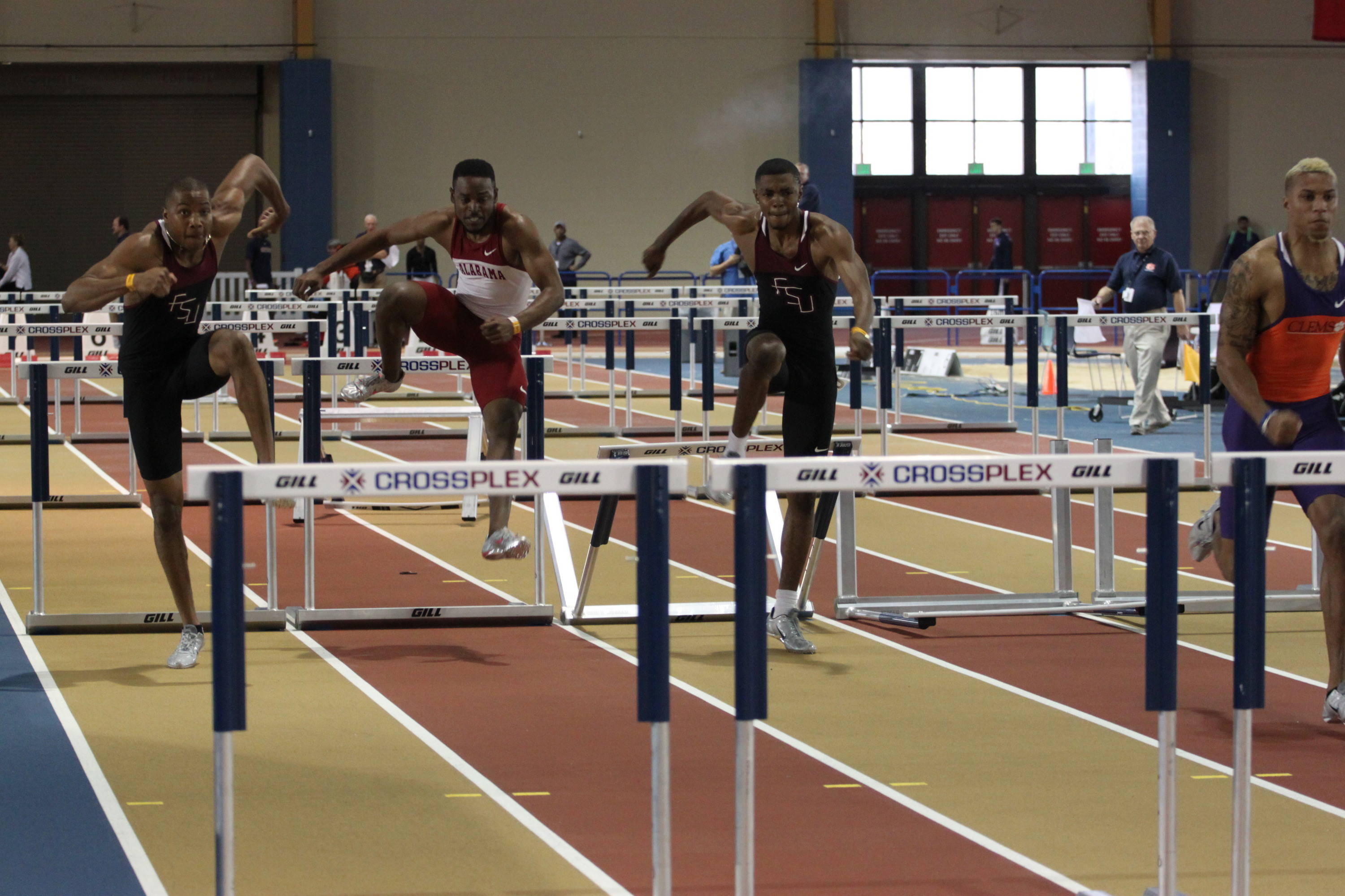 Justin Byrd (left) and Tremaine Grant (third from left) posted personal bests in the qualifying heat of the 60m hurdles at the Auburn Invitational.